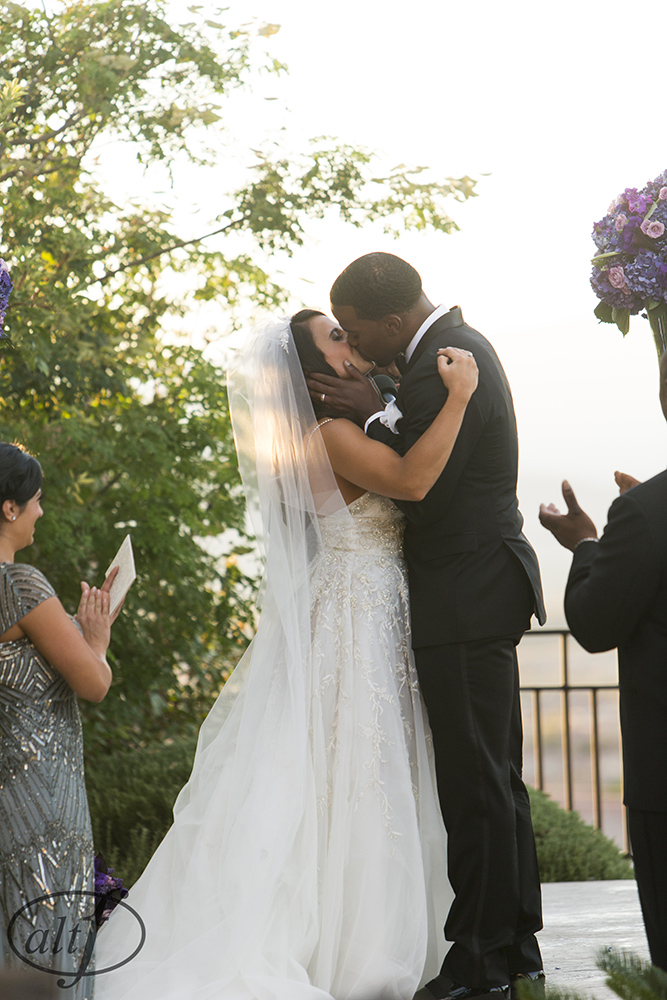 The first kiss in a backyard wedding. Pre-wedding photos of the bride and the groom, without seeing each other.  Las Vegas Wedding Planner Andrea Eppolito. Image by Altf.com.