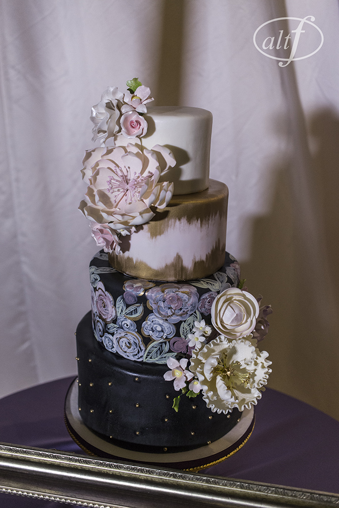 Monet inspired hand painted wedding cake in pink and gold and black. Cake by Peridot Sweets.   Las Vegas Wedding Planner Andrea Eppolito. Image by Altf.com.