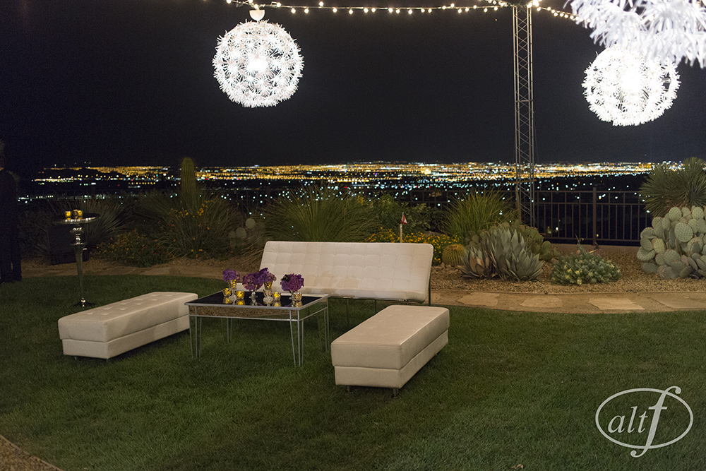 Lounge furniture outside in the company's estate.   Las Vegas Wedding Planner Andrea Eppolito. Image by Altf.com. Strip view.