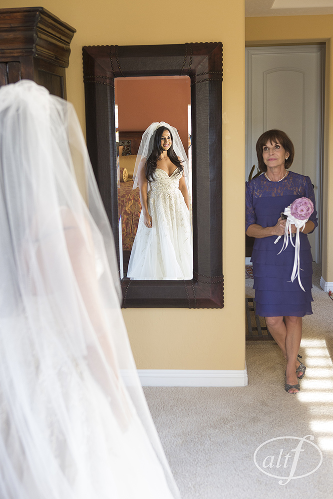 The mother of the bride watches her daughter get dressed.   Las Vegas Wedding Planner Andrea Eppolito. Image by Altf.com.
