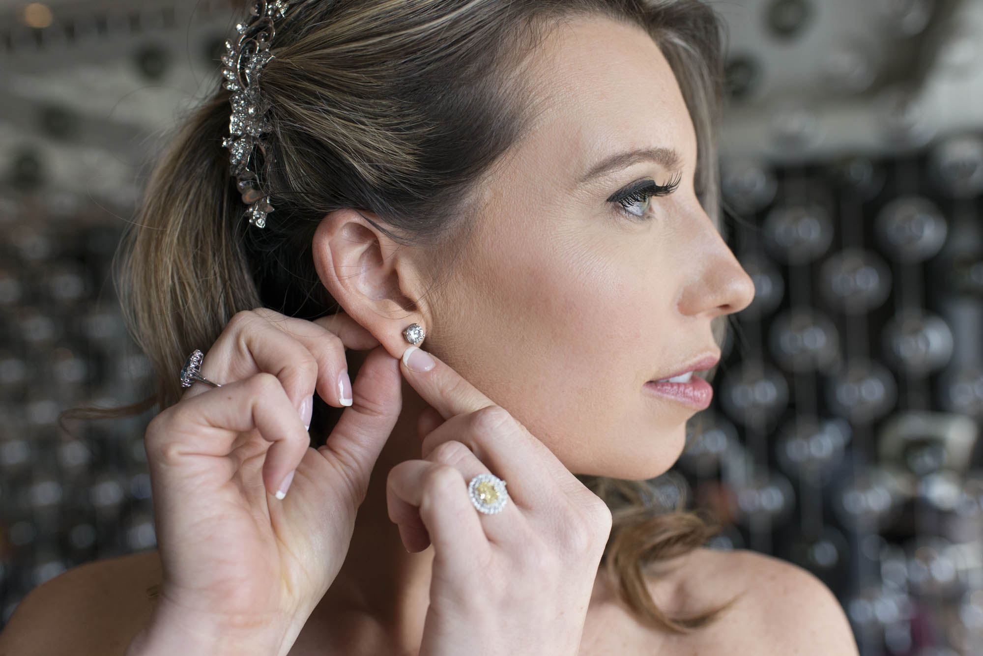 Earrings and Ring by T Bird Jewelers.   CREATIVE PARTNERS:    PHOTOGRAPHY •  AltF Photography  ,PLANNING •  Andrea Eppolito Events  ,FLORAL AND DECOR DESIGN •  Destinations by Design  ,VENUE AND CATERING •  Mandarin Oriental, Las Vegas  ,STATIONERY DESIGN •  Paper and Home  ,  BRIDE'S GOWN • Vera Wang ,SHOES • Jimmy Choo ,  GROOM'S FORMAL WEAR •  Vera Wang  ,  ENGAGEMENT RING • Delage Jewelers ,  WEDDING BANDS • T-Birds Jewels   ,  CAKE DESIGN • Mandarin Oriental Las Vegas , DRAPING;  DANCE FLOOR DESIGN AND PRODUCTION • Destination by Design ,  LIVE EVENT ARTIST • Sam Day ,ENTERTAINMENT  • Lucky Devils Band ,CINEMATOGRAPHY • Something New