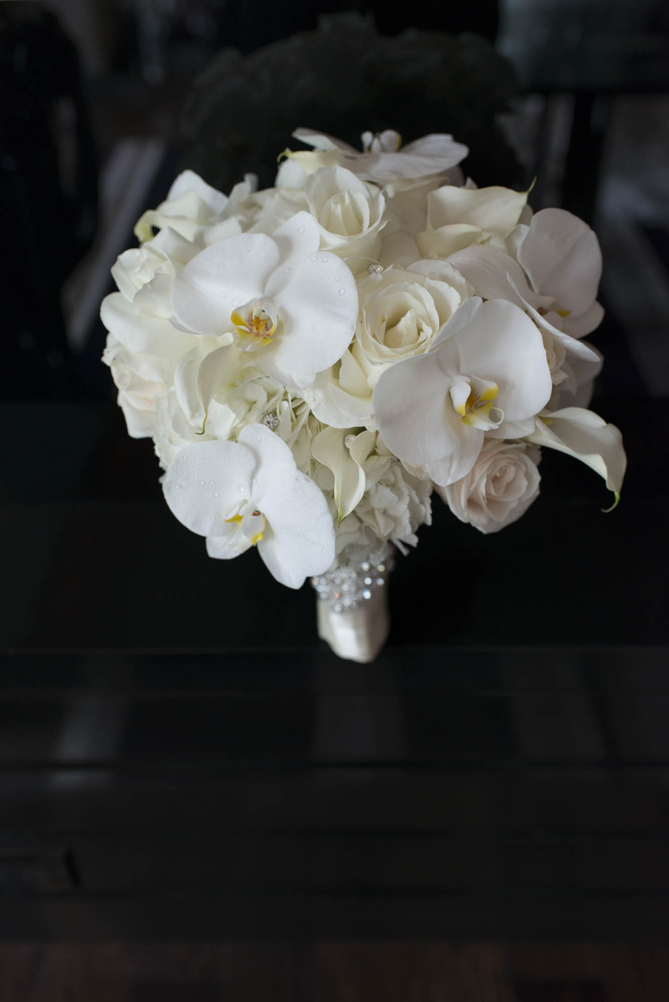 White Bridal Bouquet with orchids, hydrangea, and roses.    CREATIVE PARTNERS:    PHOTOGRAPHY •  AltF Photography  ,PLANNING •  Andrea Eppolito Events  ,FLORAL AND DECOR DESIGN •  Destinations by Design  ,VENUE AND CATERING •  Mandarin Oriental, Las Vegas  ,STATIONERY DESIGN •  Paper and Home  ,  BRIDE'S GOWN • Vera Wang ,SHOES • Jimmy Choo ,  GROOM'S FORMAL WEAR •  Vera Wang  ,  ENGAGEMENT RING • Delage Jewelers ,  WEDDING BANDS • T-Birds Jewels   ,  CAKE DESIGN • Mandarin Oriental Las Vegas , DRAPING;  DANCE FLOOR DESIGN AND PRODUCTION • Destination by Design ,  LIVE EVENT ARTIST • Sam Day ,ENTERTAINMENT  • Lucky Devils Band ,CINEMATOGRAPHY • Something New