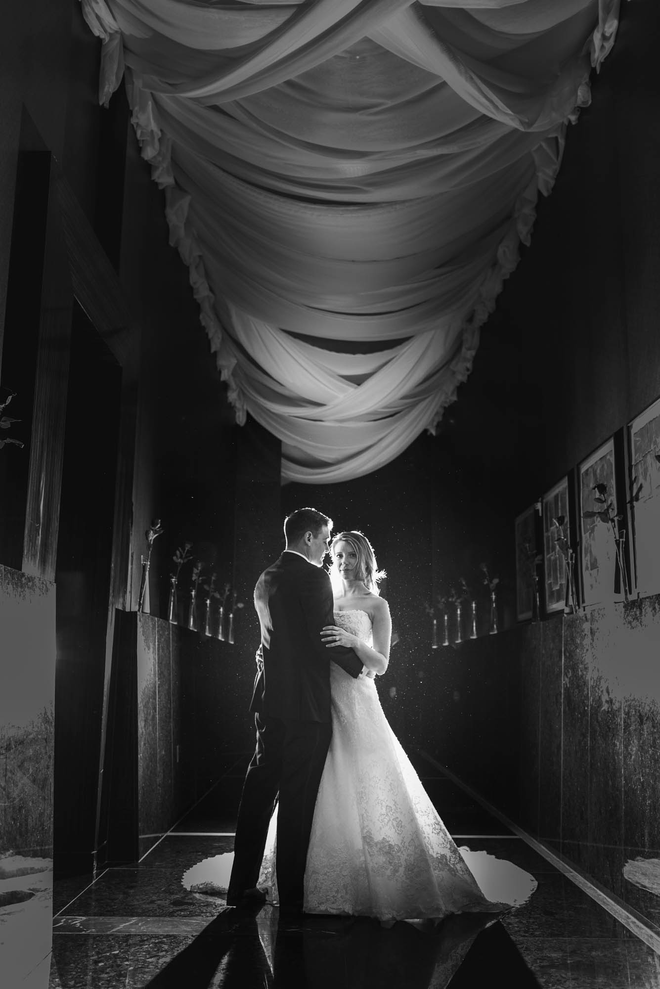 Black and white Dramatic High Fashion Wedding Photo.   CREATIVE PARTNERS:    PHOTOGRAPHY •  AltF Photography  ,PLANNING •  Andrea Eppolito Events  ,FLORAL AND DECOR DESIGN •  Destinations by Design  ,VENUE AND CATERING •  Mandarin Oriental, Las Vegas  ,STATIONERY DESIGN •  Paper and Home  ,  BRIDE'S GOWN • Vera Wang ,SHOES • Jimmy Choo ,  GROOM'S FORMAL WEAR •  Vera Wang  ,  ENGAGEMENT RING • Delage Jewelers ,  WEDDING BANDS • T-Birds Jewels   ,  CAKE DESIGN • Mandarin Oriental Las Vegas , DRAPING;  DANCE FLOOR DESIGN AND PRODUCTION • Destination by Design ,  LIVE EVENT ARTIST • Sam Day ,ENTERTAINMENT  • Lucky Devils Band ,CINEMATOGRAPHY • Something New