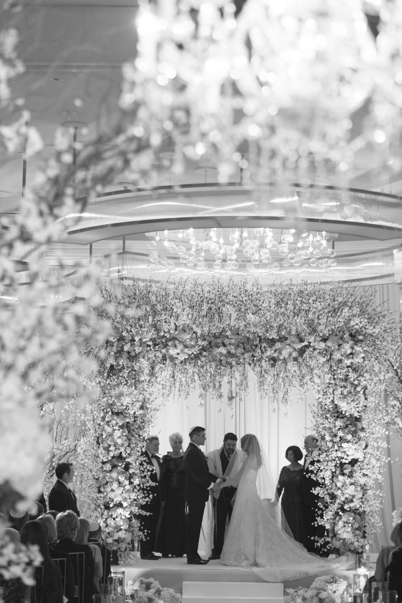 CREDITS:    PHOTOGRAPHY •  AltF Photography  ,PLANNING •  Andrea Eppolito Events  ,FLORAL AND DECOR DESIGN •  Destinations by Design  ,VENUE AND CATERING •  Mandarin Oriental, Las Vegas  ,STATIONERY DESIGN •  Paper and Home  ,  BRIDE'S GOWN • Vera Wang ,SHOES • Jimmy Choo ,  GROOM'S FORMAL WEAR •  Vera Wang  ,  ENGAGEMENT RING • Delage Jewelers ,  WEDDING BANDS • T-Birds Jewels   ,  CAKE DESIGN • Mandarin Oriental Las Vegas , DRAPING;  DANCE FLOOR DESIGN AND PRODUCTION • Destination by Design ,  LIVE EVENT ARTIST • Sam Day ,ENTERTAINMENT  • Lucky Devils Band ,CINEMATOGRAPHY • Something New