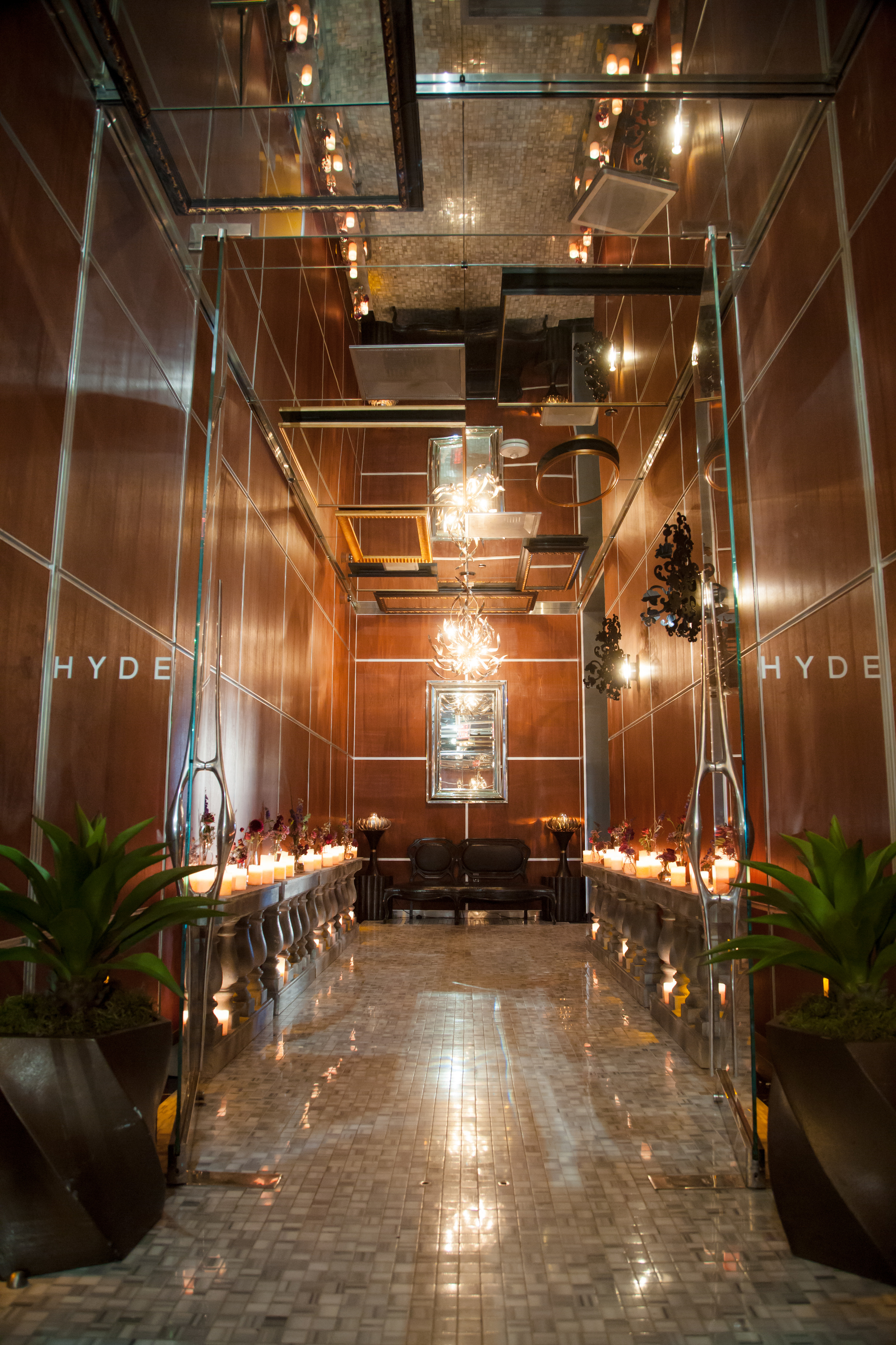 Candlelit entry into Hyde Bellagio for a wedding showcase. Las Vegas Wedding Planner and Event Designer Andrea Eppolito produces an Atonement themed party for The Knot Rocks JCK 2016 for The Knot Pro. Photo by Adam Frazier.