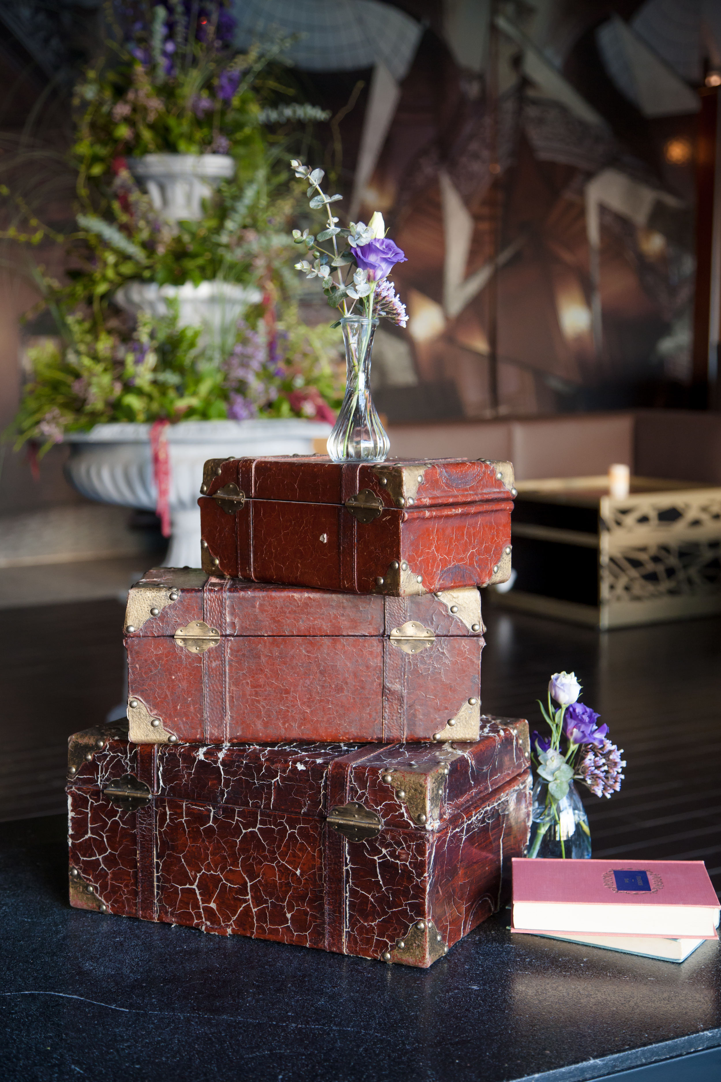 We drew inspiration from the movie Atonement and went with a vintage, 1920's style of decor with vintage suitcases and old cameras  .  Las Vegas Wedding Planner and Eve  nt Designer Andrea Eppolito produces an Atonement themed party for  The Knot Rocks JCK 2016 for The Knot Pro. Photo by Adam Frazier.