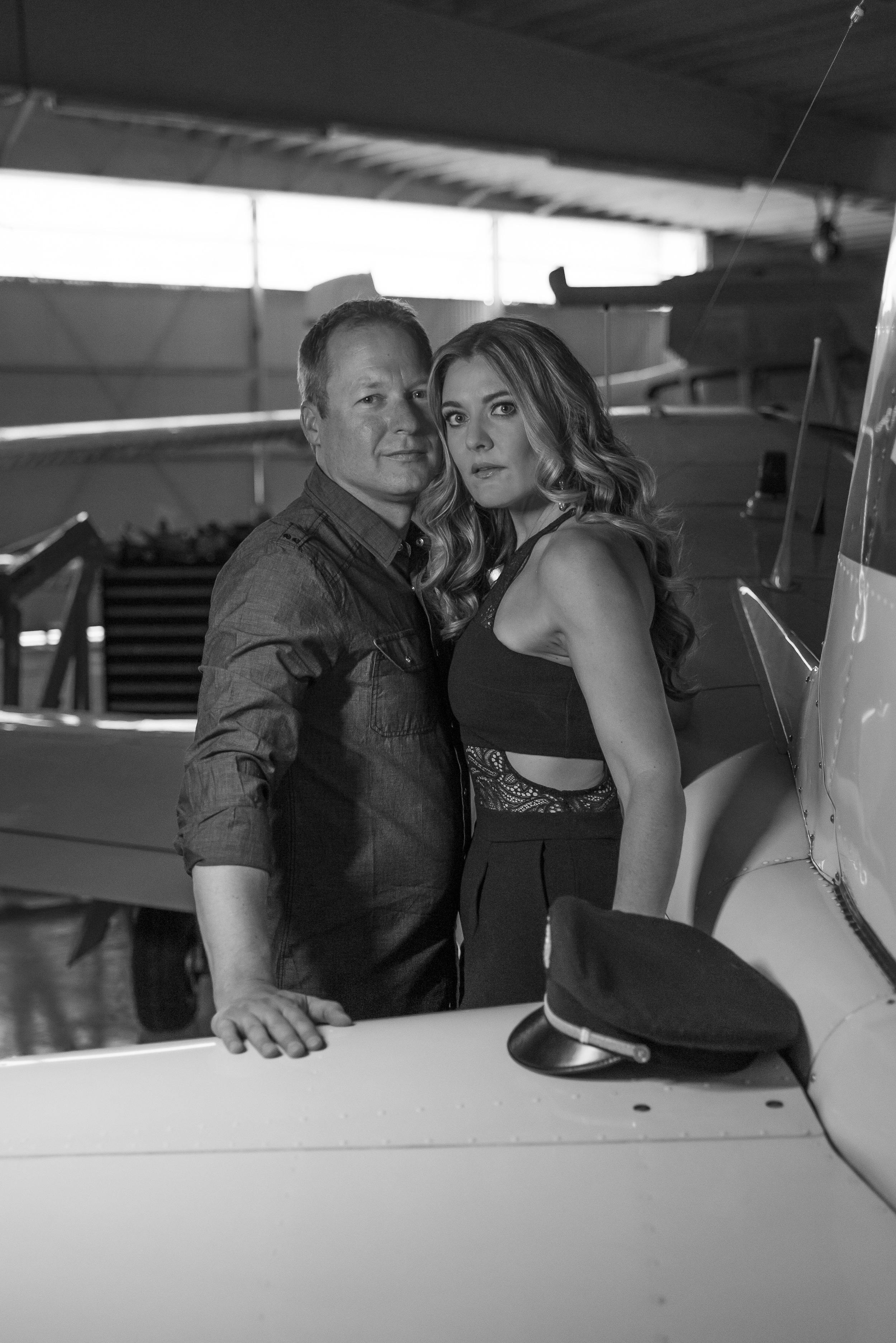 Destination Wedding Planner Andrea Eppolito | Engagement Photos in an Airplane Hanger | Images by  AltF Photography  | Black and White images with a plane