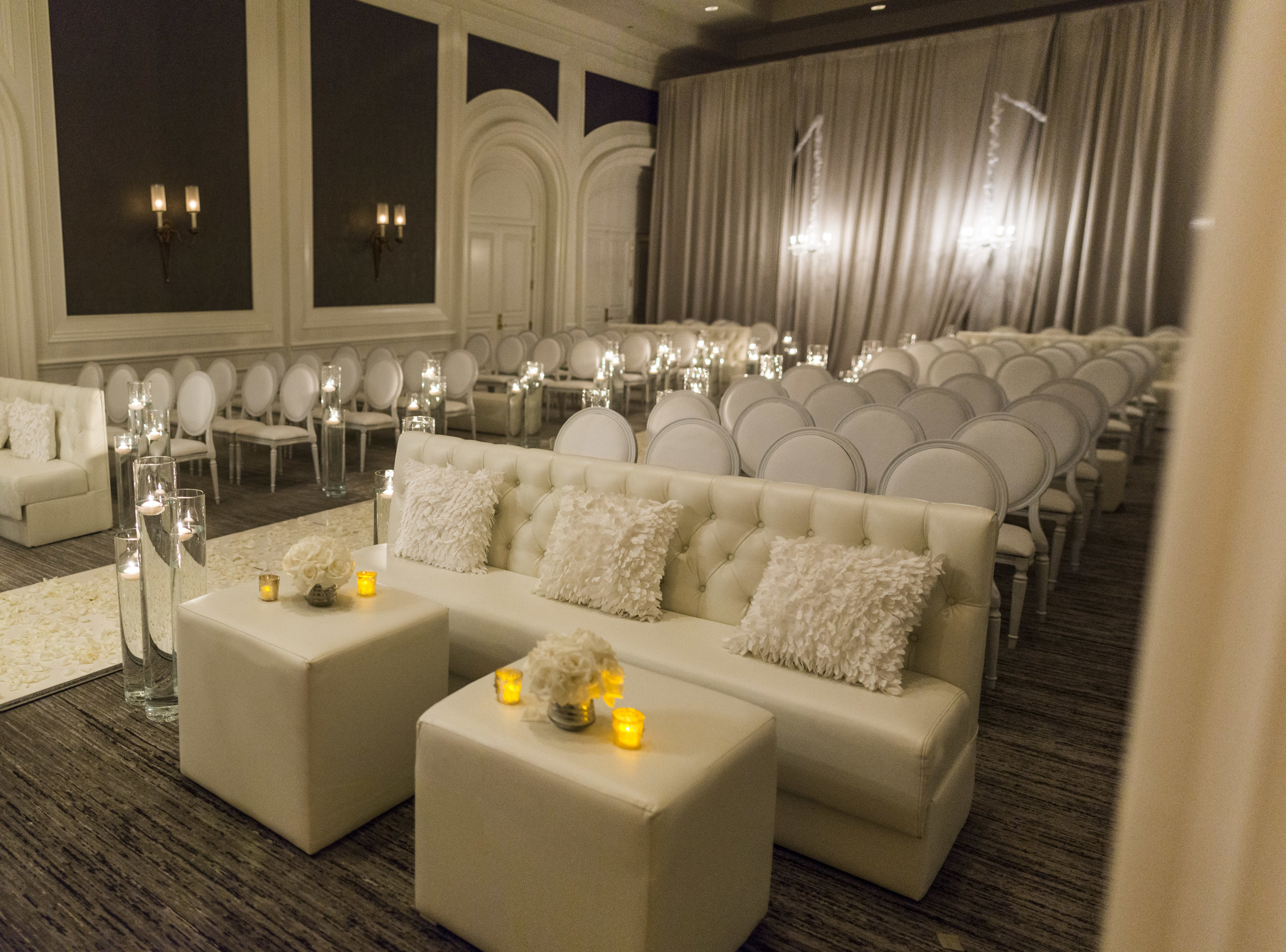 White on white wedding with chandelier entry. Wedding by Las Vegas Wedding Planner Andrea Eppolito. Wedding at Four Seasons Las Vegas.  Image by AltF Photography.