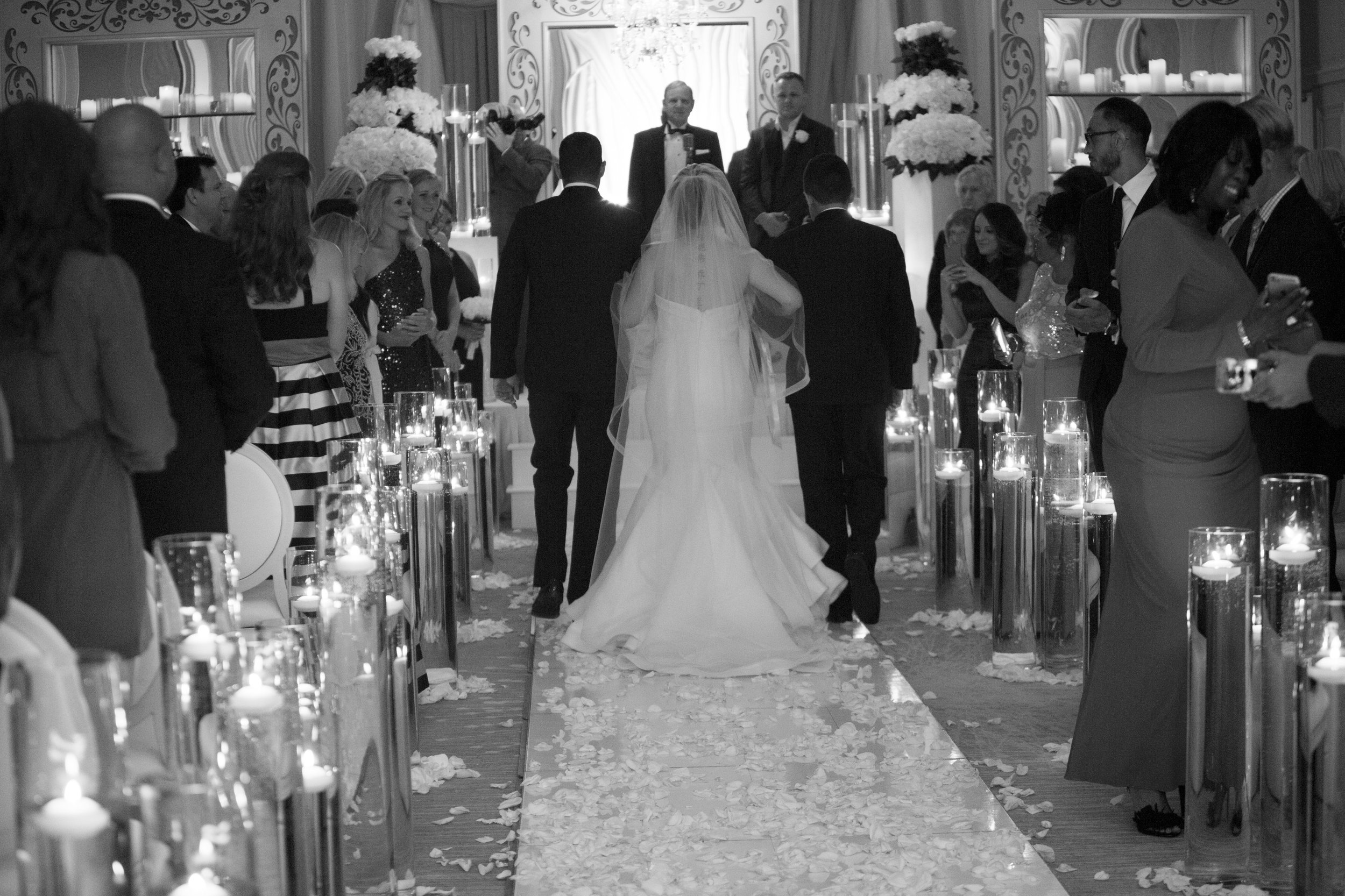 Bride being given away by her sons.  Four Seasons Wedding by Las Vegas Wedding Planner Andrea Eppolito. Image by AltF Photography. Decor by DBD Vegas.