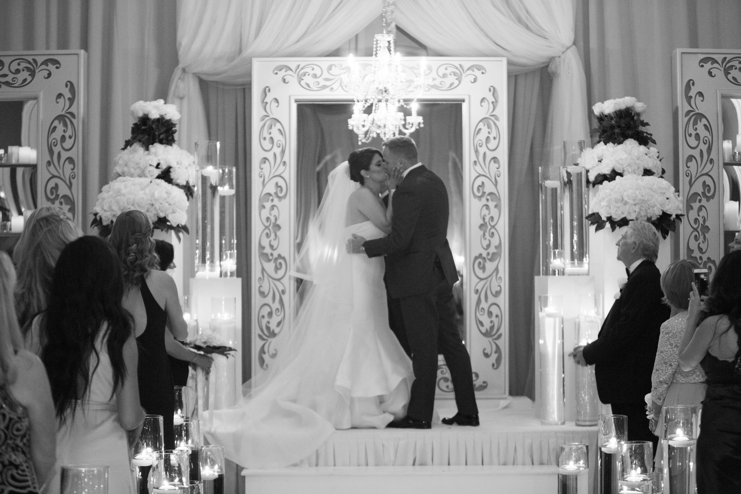 The first kiss in black and white. Four Seasons Wedding by Las Vegas Wedding Planner Andrea Eppolito. Image by AltF Photography. Decor by DBD Vegas.