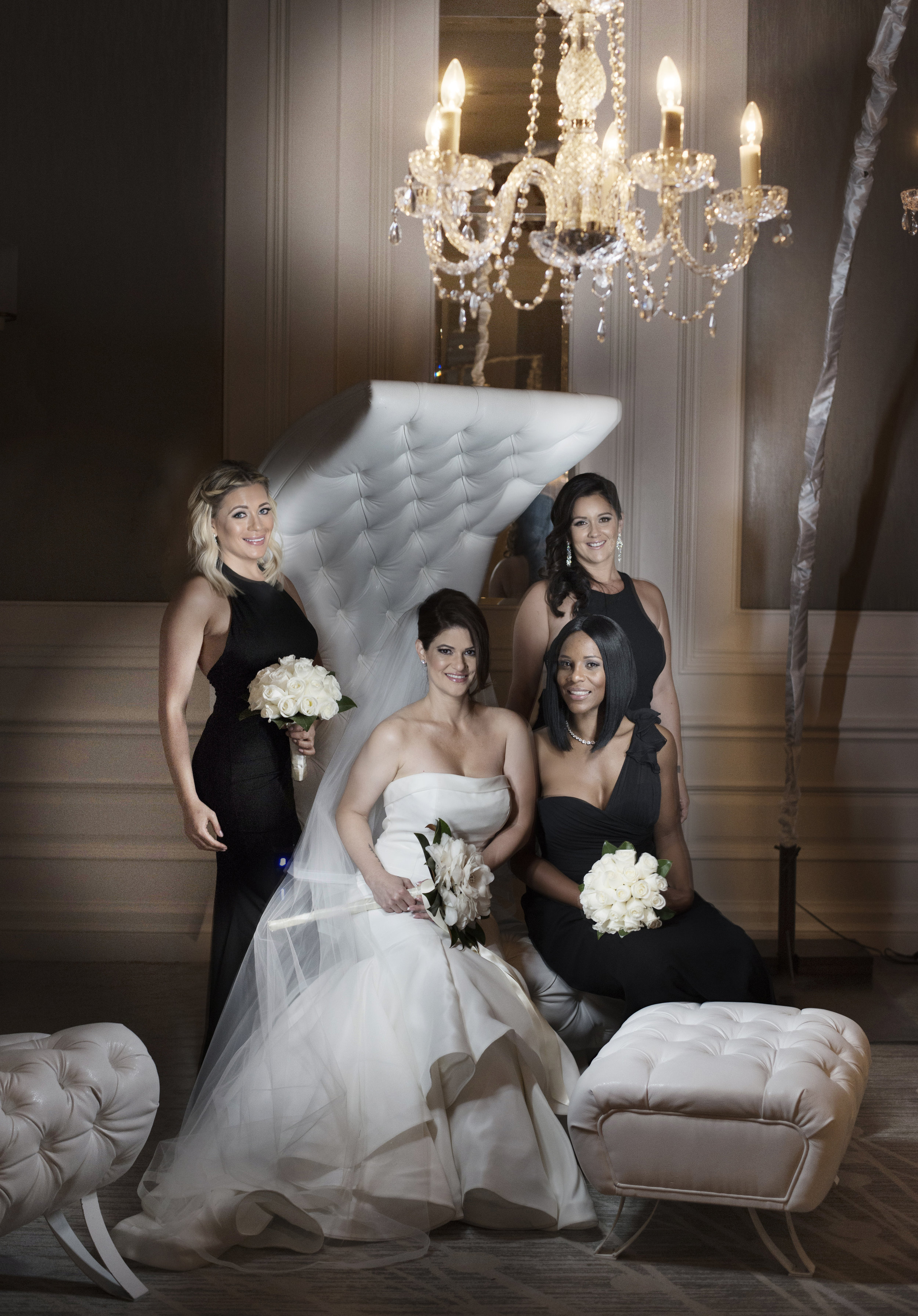 Bride and bridesmaid in chandelier seating area.  Four Seasons Wedding by Las Vegas Wedding Planner Andrea Eppolito. Image by AltF Photography. Decor by DBD Vegas.
