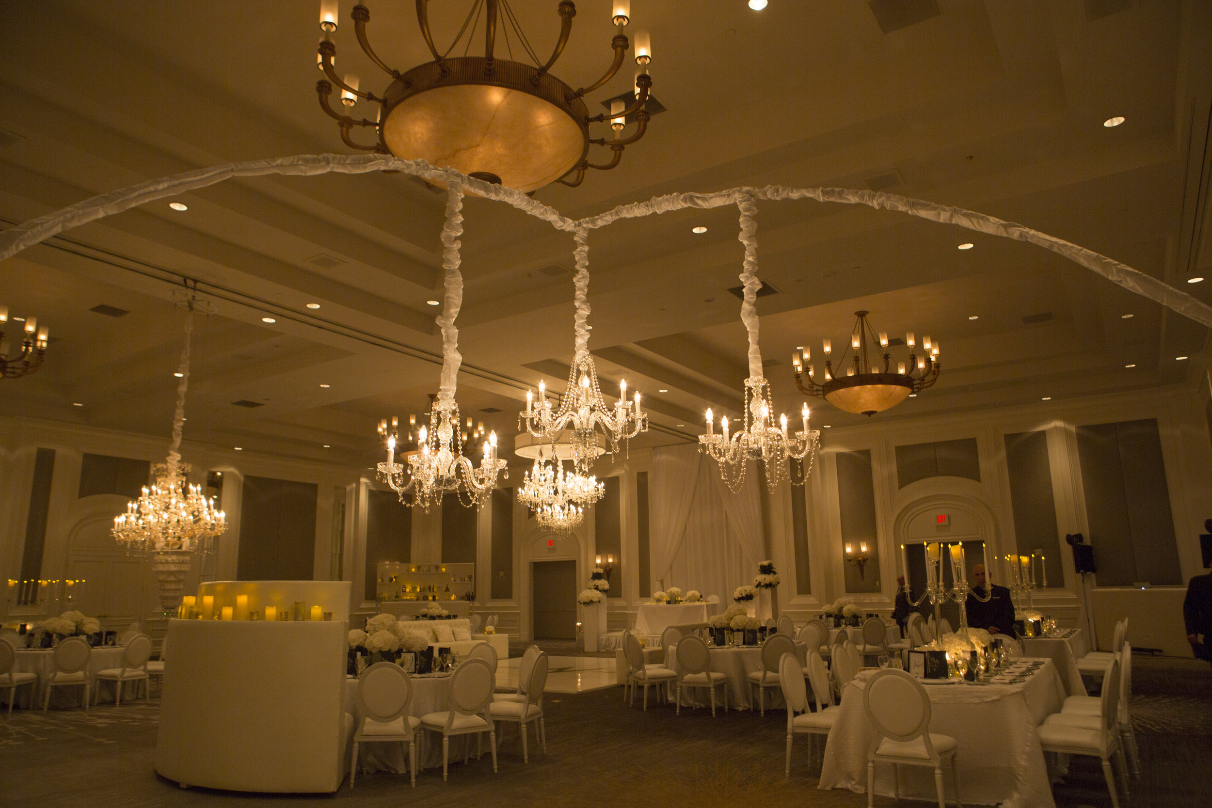 Chandelier wedding with white on white decor.  Four Seasons Wedding by Las Vegas Wedding Planner Andrea Eppolito. Image by AltF Photography. Decor by DBD Vegas.