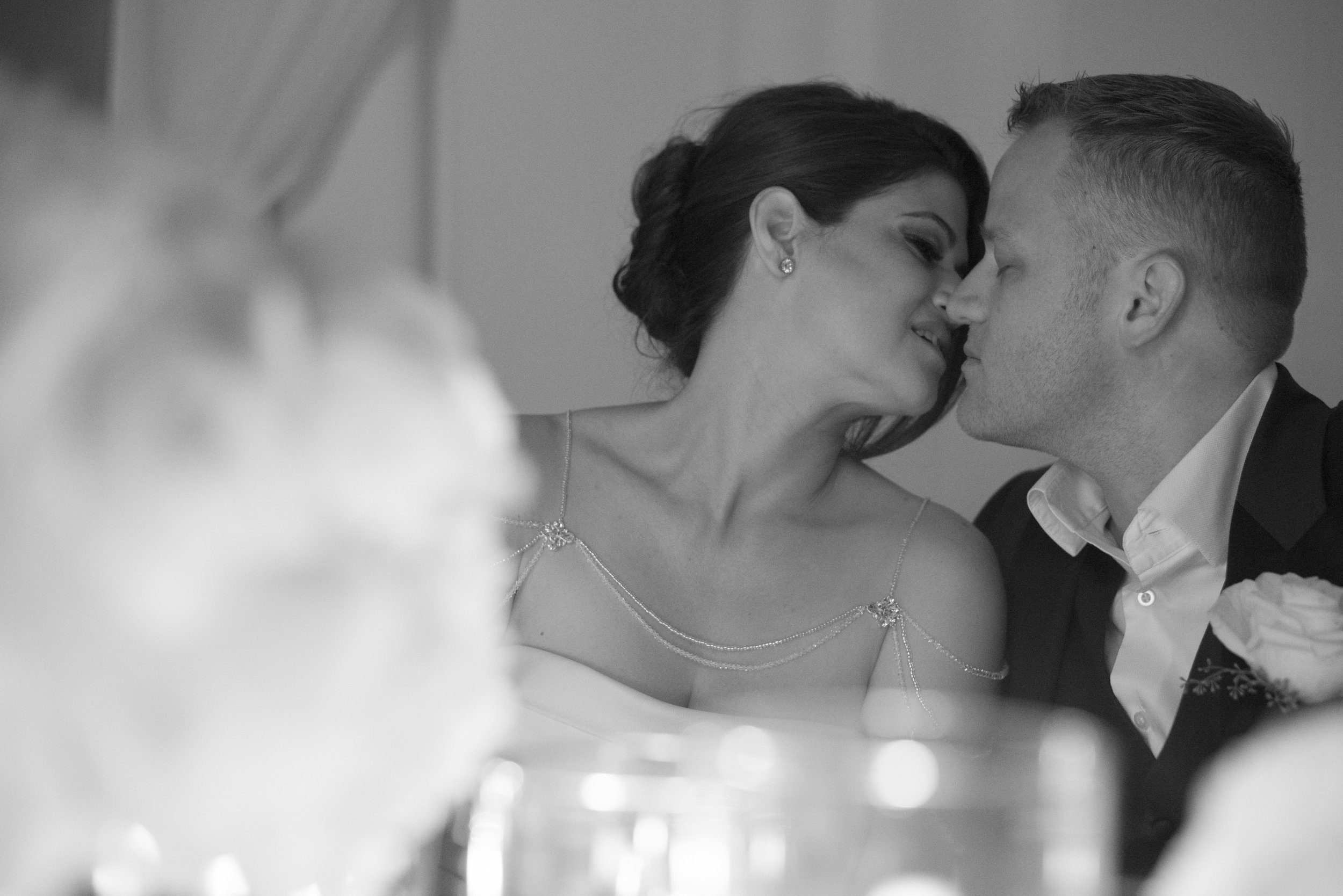 Quite kisses in a wedding reception.  Four Seasons Wedding by Las Vegas Wedding Planner Andrea Eppolito. Image by AltF Photography. Decor by DBD Vegas. EntreeEnr