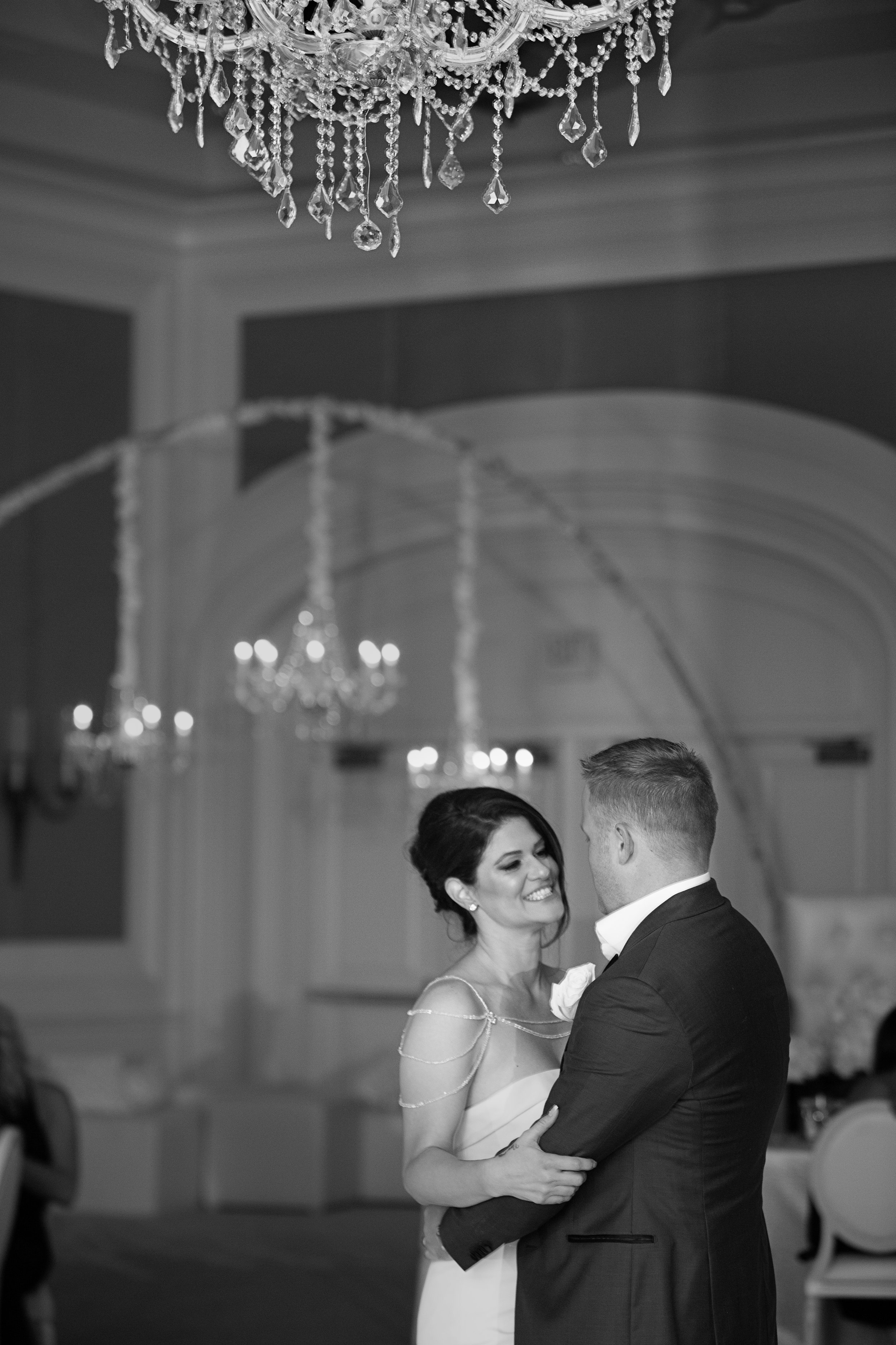 The first dance under a chandelier.  Four Seasons Wedding by Las Vegas Wedding Planner Andrea Eppolito. Image by AltF Photography. Decor by DBD Vegas.