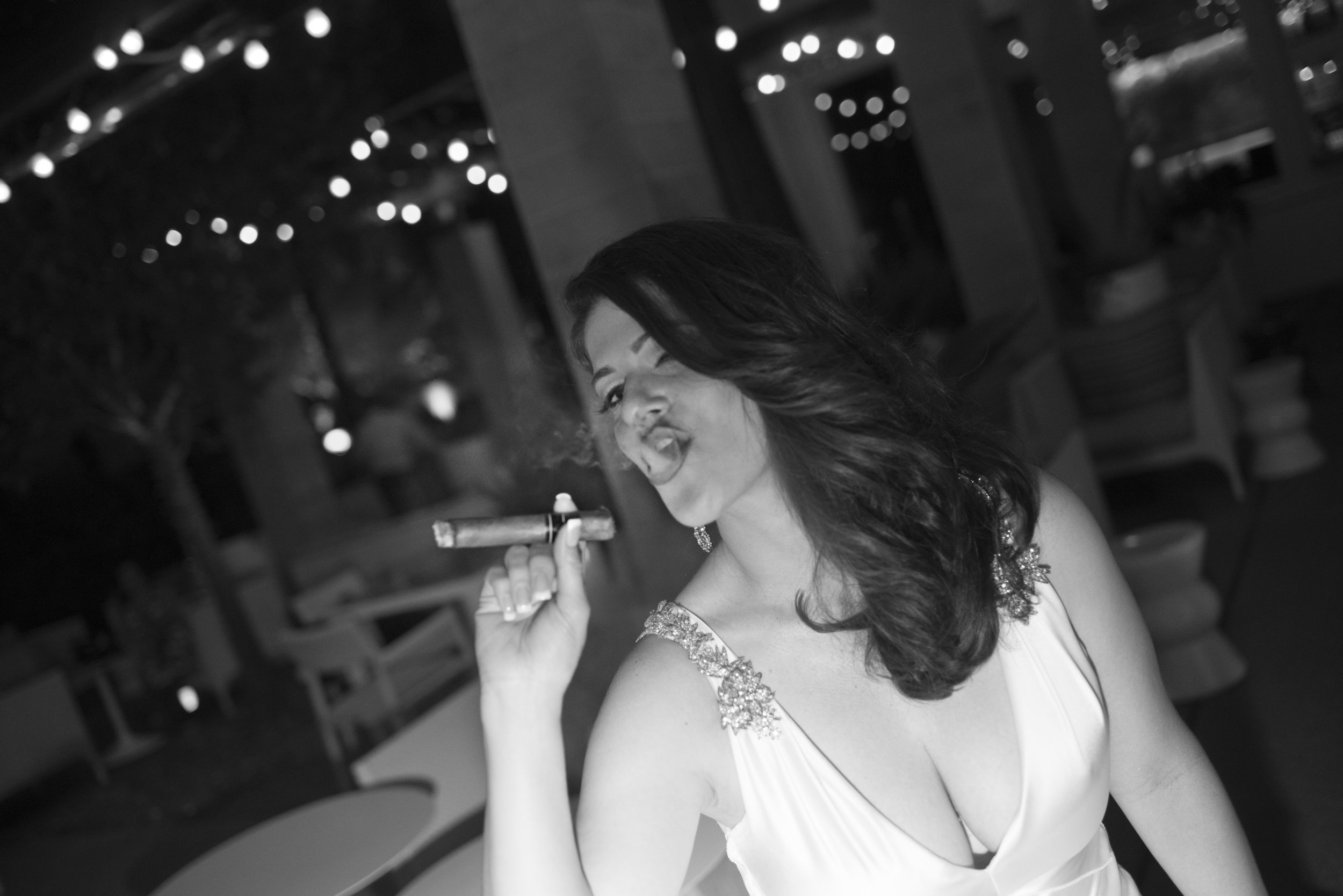 Goodnight! Bride with cigar.  Four Seasons Wedding by Las Vegas Wedding Planner Andrea Eppolito. Image by AltF Photography. Decor by DBD Vegas. After party taco truck. After