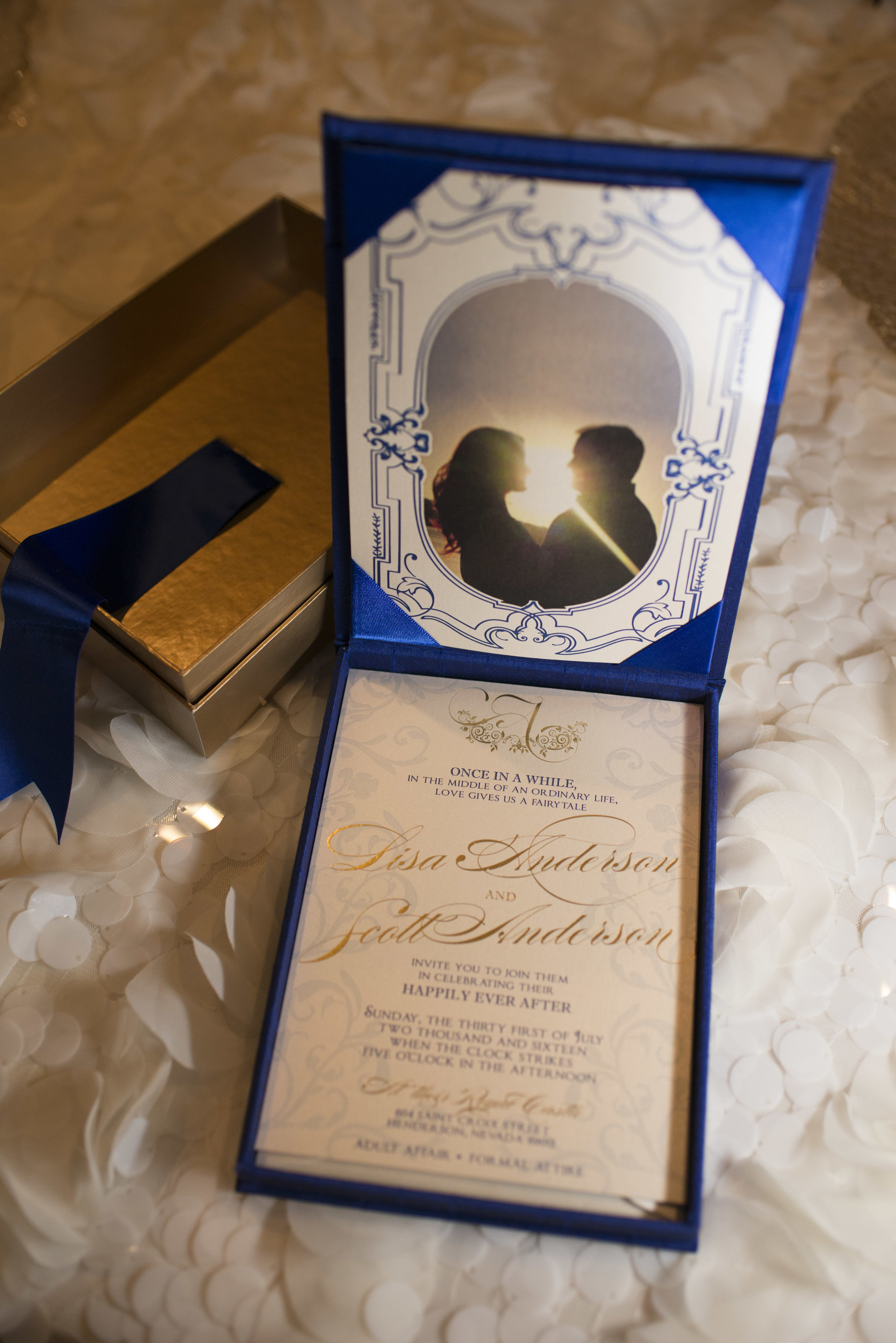 Boxed invitation with photo of the bride and groom by Paper and Home.Luxury Las Vegas Wedding Planner Andrea Eppolito. Image by AltF Photography.