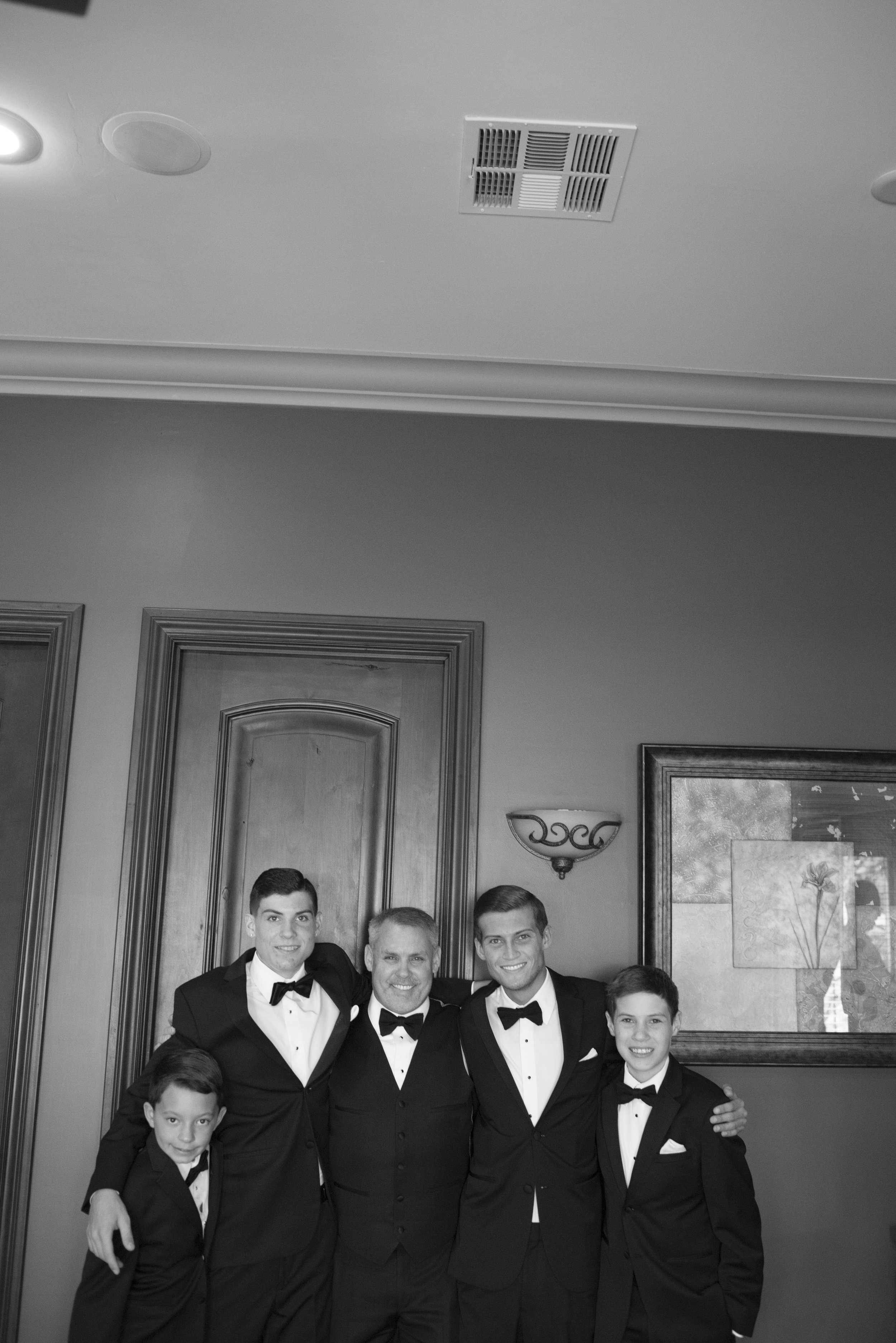 Groom Scott with his sons and groomsmen before the wedding. Luxury Las Vegas Wedding Planner Andrea Eppolito. Image by AltF Photography.