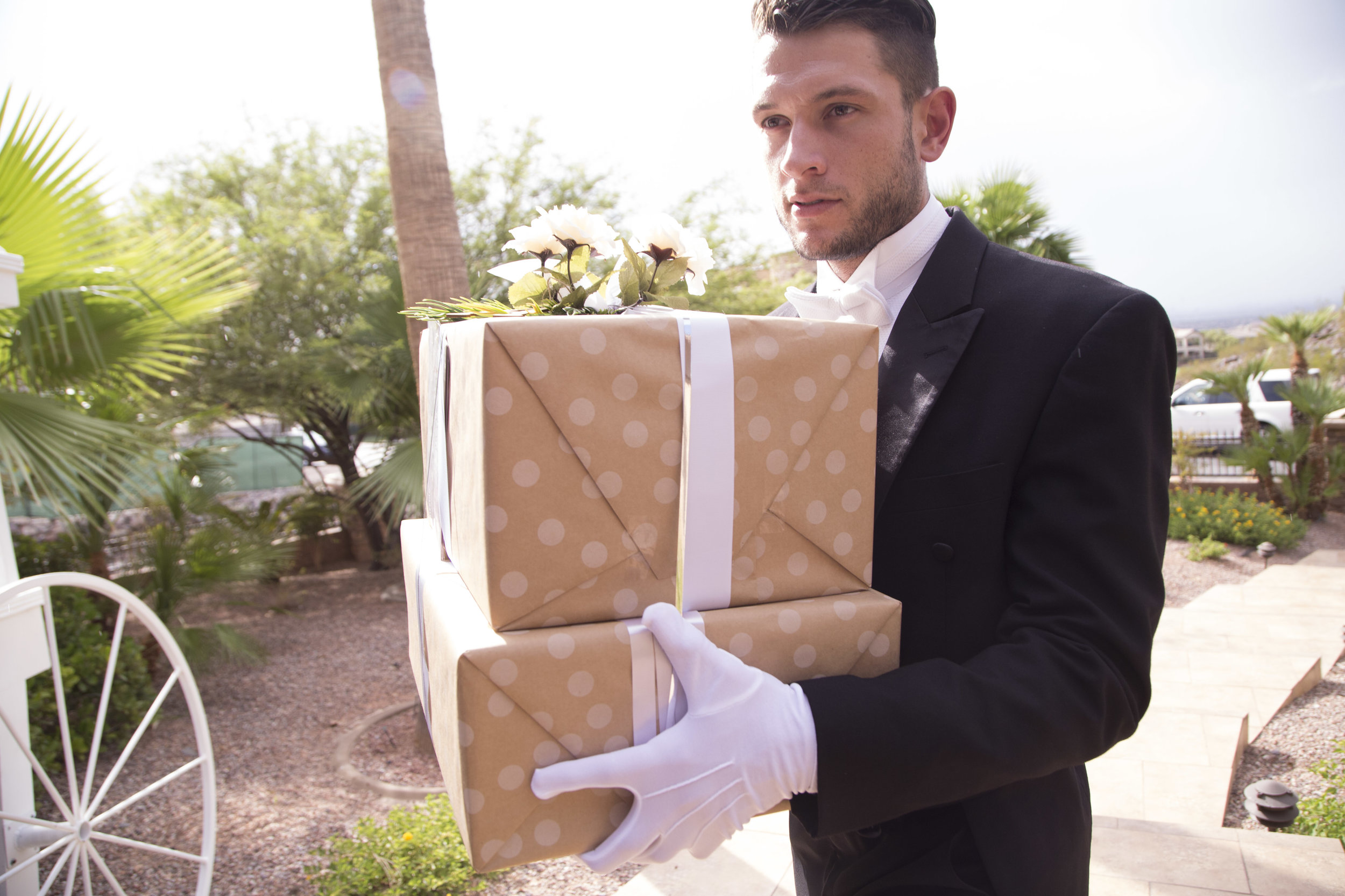 Butler accepts gifts and carries them into the house for the bride and groom. Luxury Las Vegas Wedding Planner Andrea Eppolito. Image by AltF Photography.