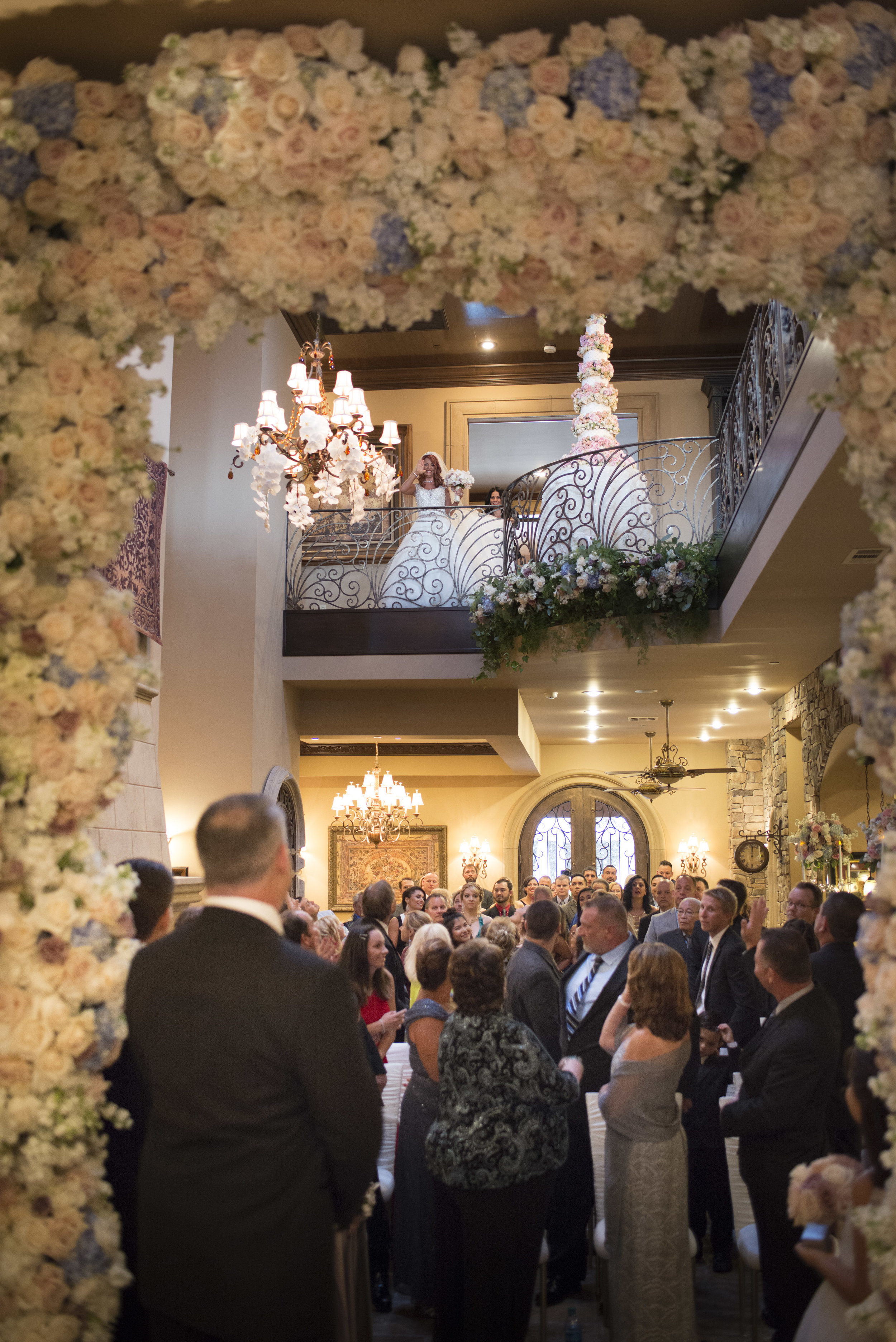 Groom watches bride emerge from the second story balcony. Luxury Las Vegas Wedding Planner Andrea Eppolito. Image by AltF Photography.
