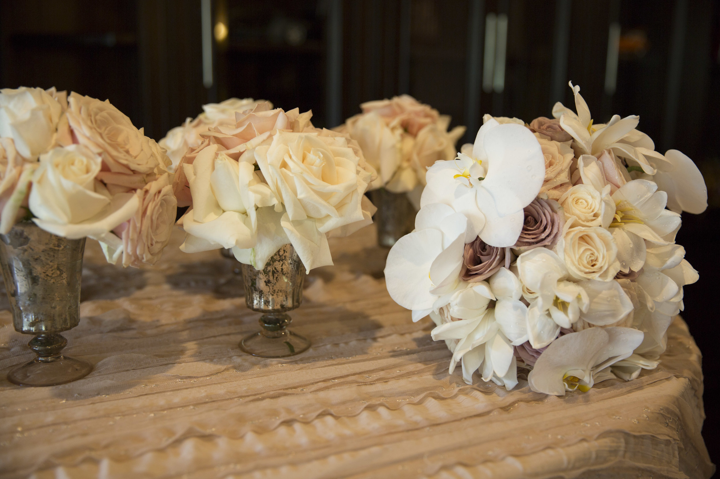 Bridal bouquet with orchids, open tulips, and roses. Luxury Las Vegas Wedding Planner Andrea Eppolito. Image by AltF Photography.
