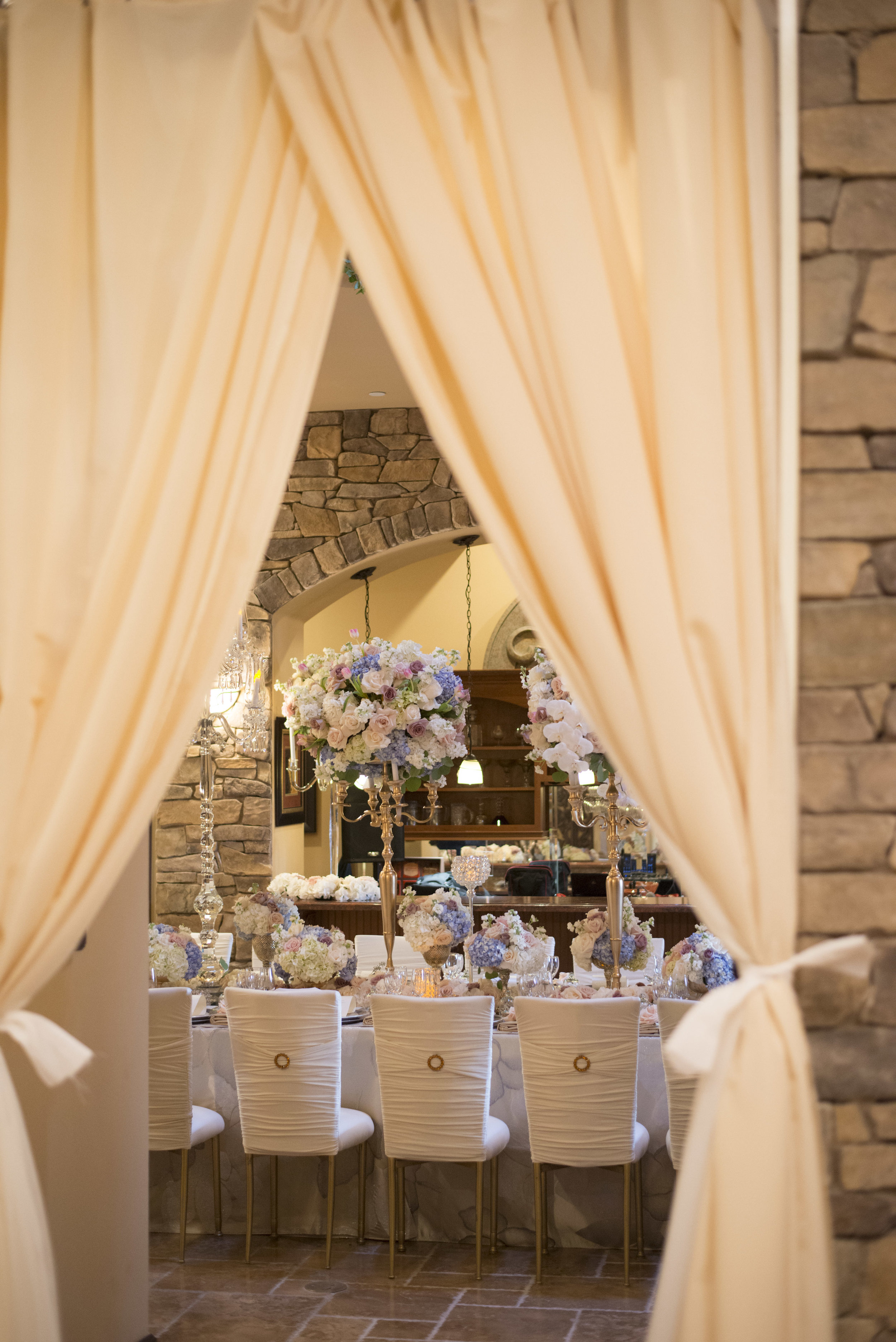 Three rooms were used to seat all of our guests. Guests passed through curtains to get from one space to another. Luxury Las Vegas Wedding Planner Andrea Eppolito. Image by AltF Photography.