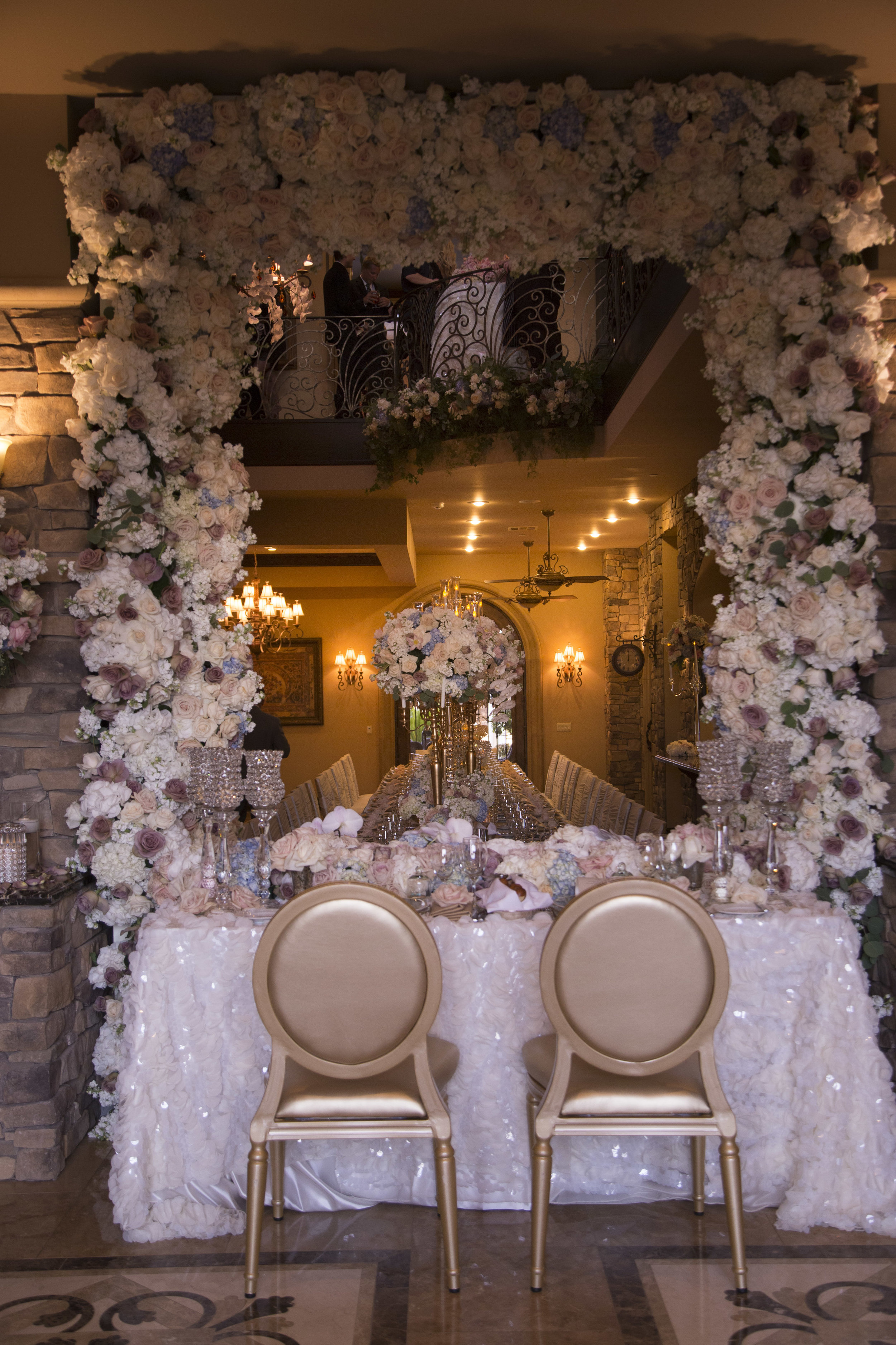 Sweetheart table with gold chairs and sequence flutter linen. Luxury Las Vegas Wedding Planner Andrea Eppolito. Image by AltF Photography. Table by DBD Vegas.