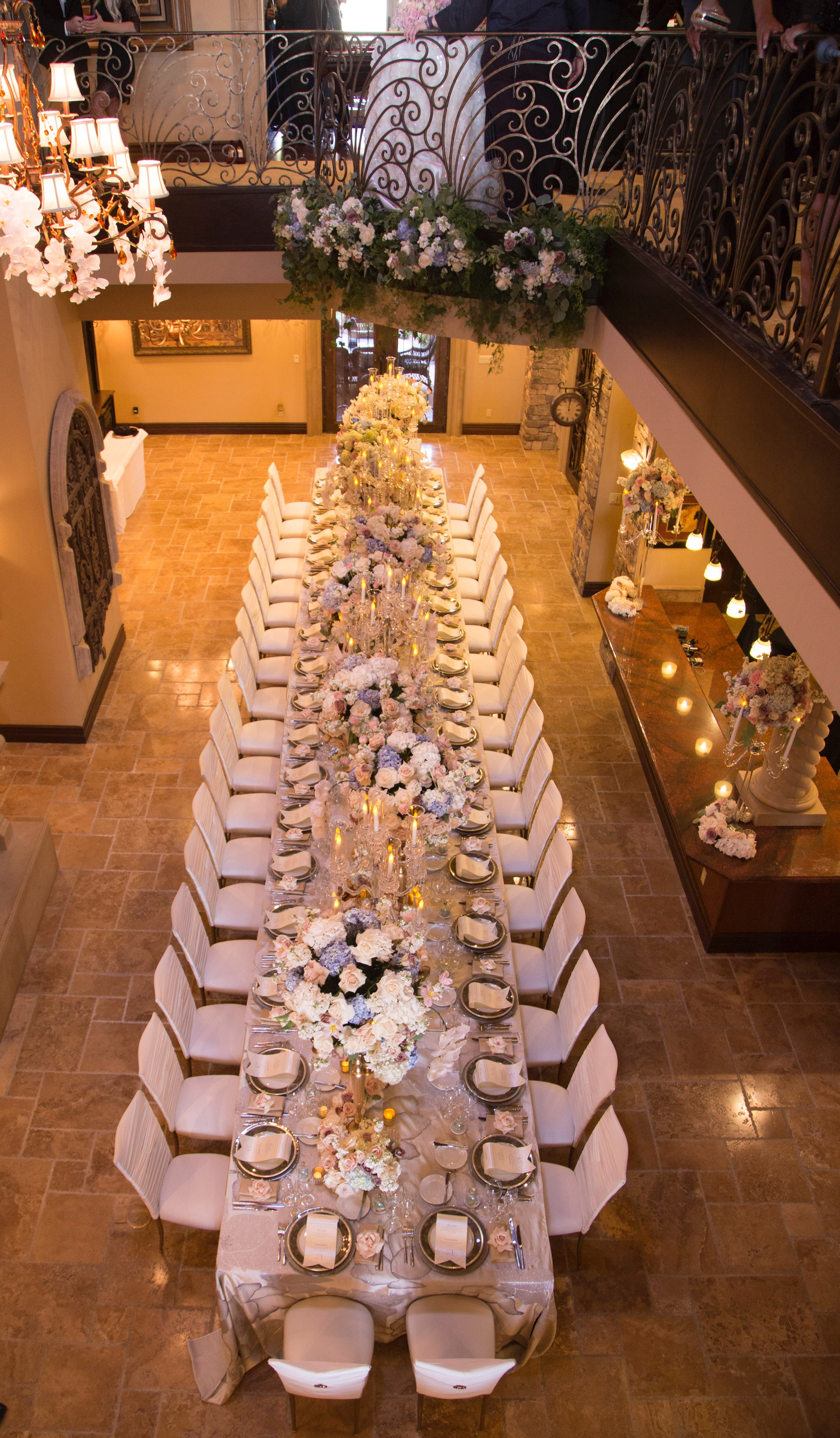 Royal long banquet table in the grand foyer of castle wedding