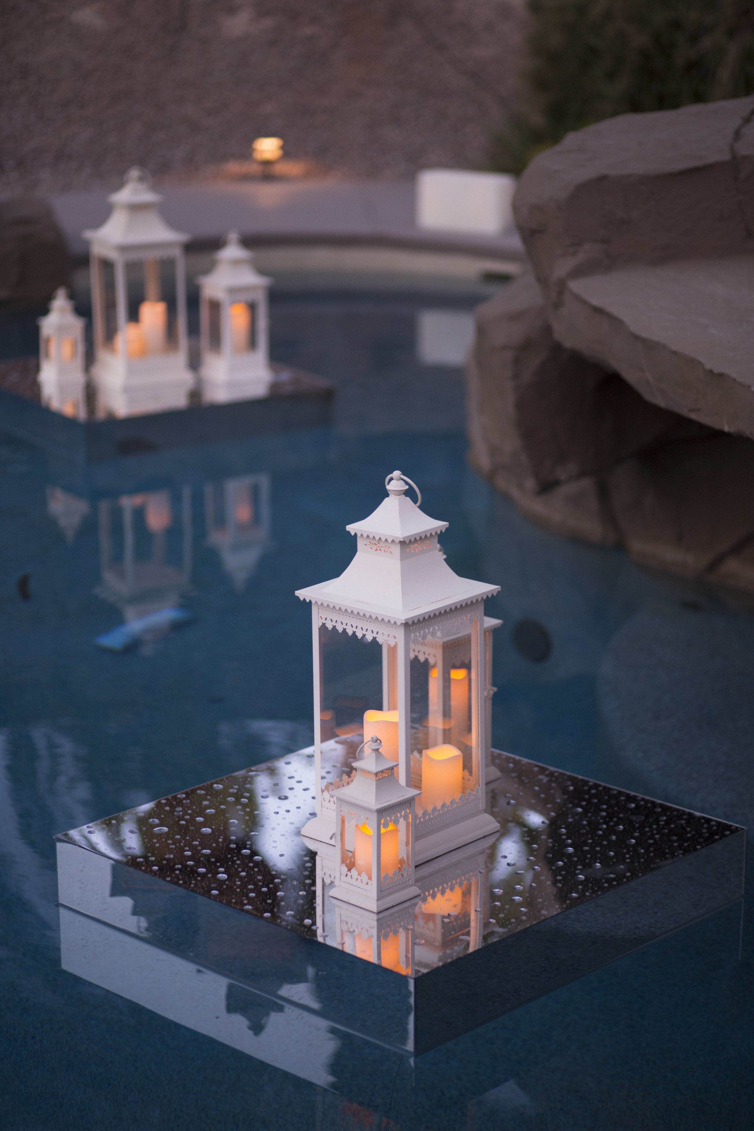 Floating Lanterns in the pool at Castle Style Luxury Estate wedding iN las Vegas. Luxury Las Vegas Wedding Planner Andrea Eppolito. Image by AltF Photography.
