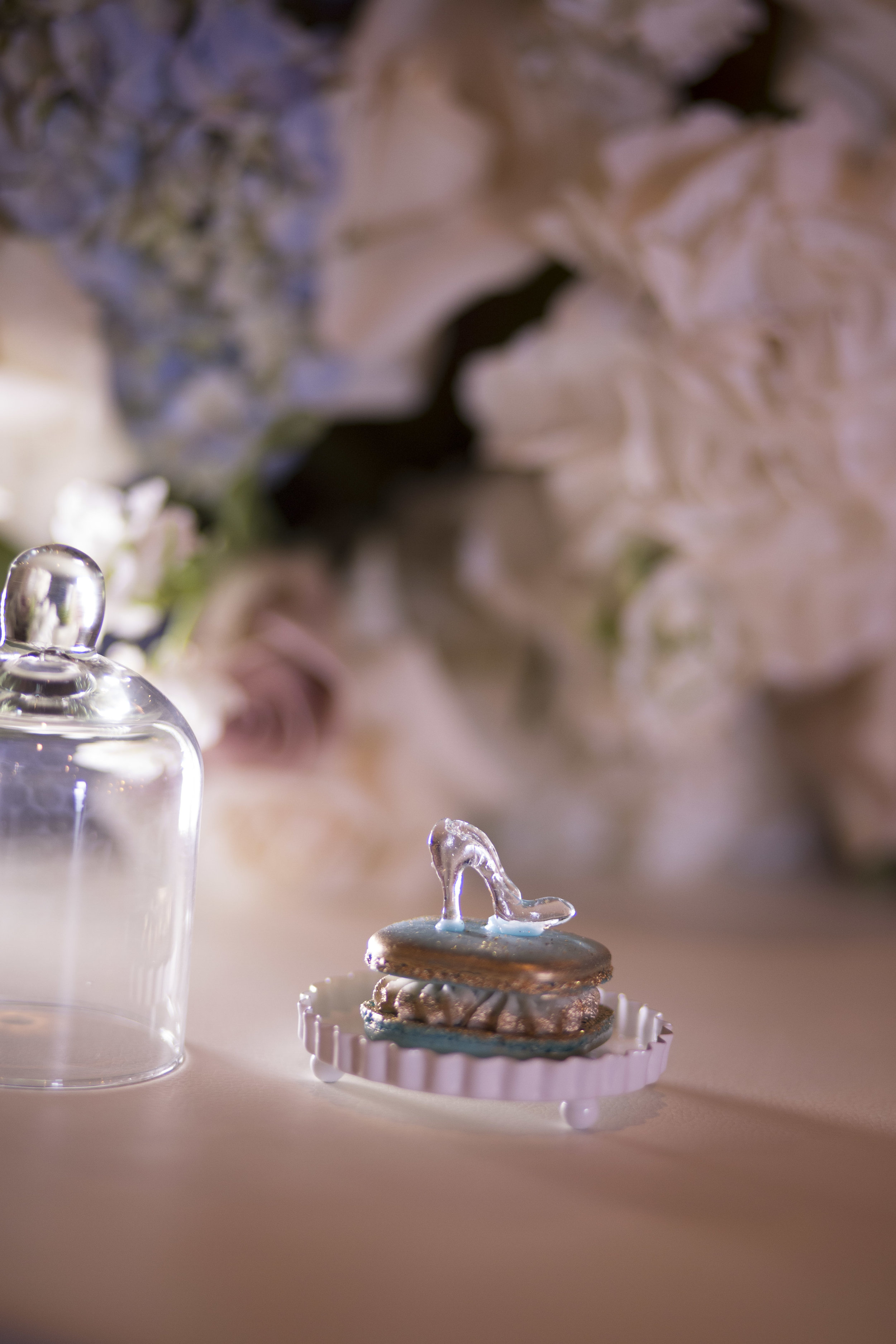 Sugar Favor - Each guests received a hand blown sugar glass slipped placed on a macaroon pillow and presented under glass for the perfect cinderella wedding. Luxury Las Vegas Wedding Planner Andrea Eppolito. Image by AltF Photography.  Luxury Las Vegas Wedding Planner Andrea Eppolito. Image by AltF Photography.