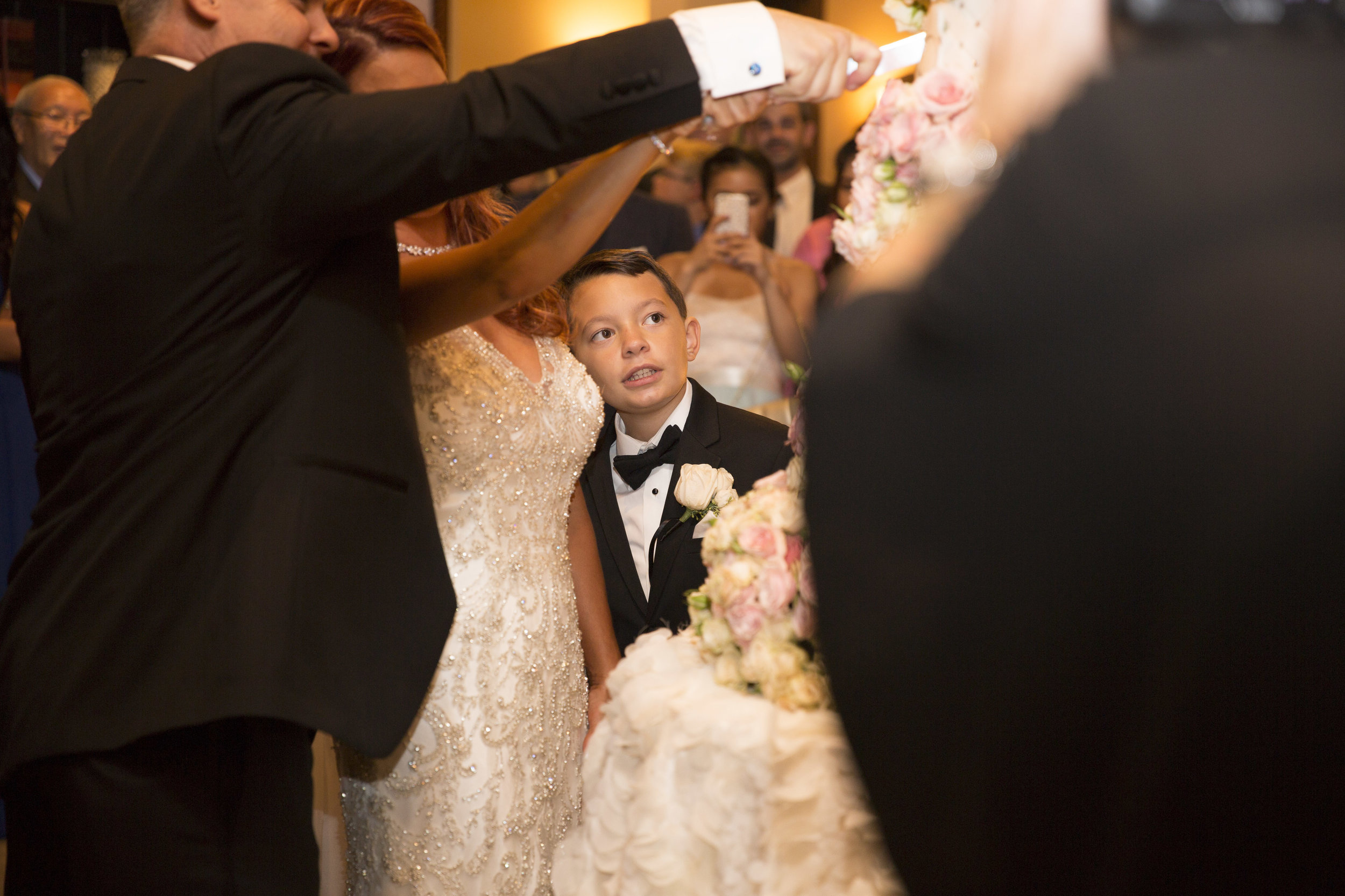 The bride and groom cut the cake while her son watches. Luxury Las Vegas Wedding Planner Andrea Eppolito. Image by AltF Photography.