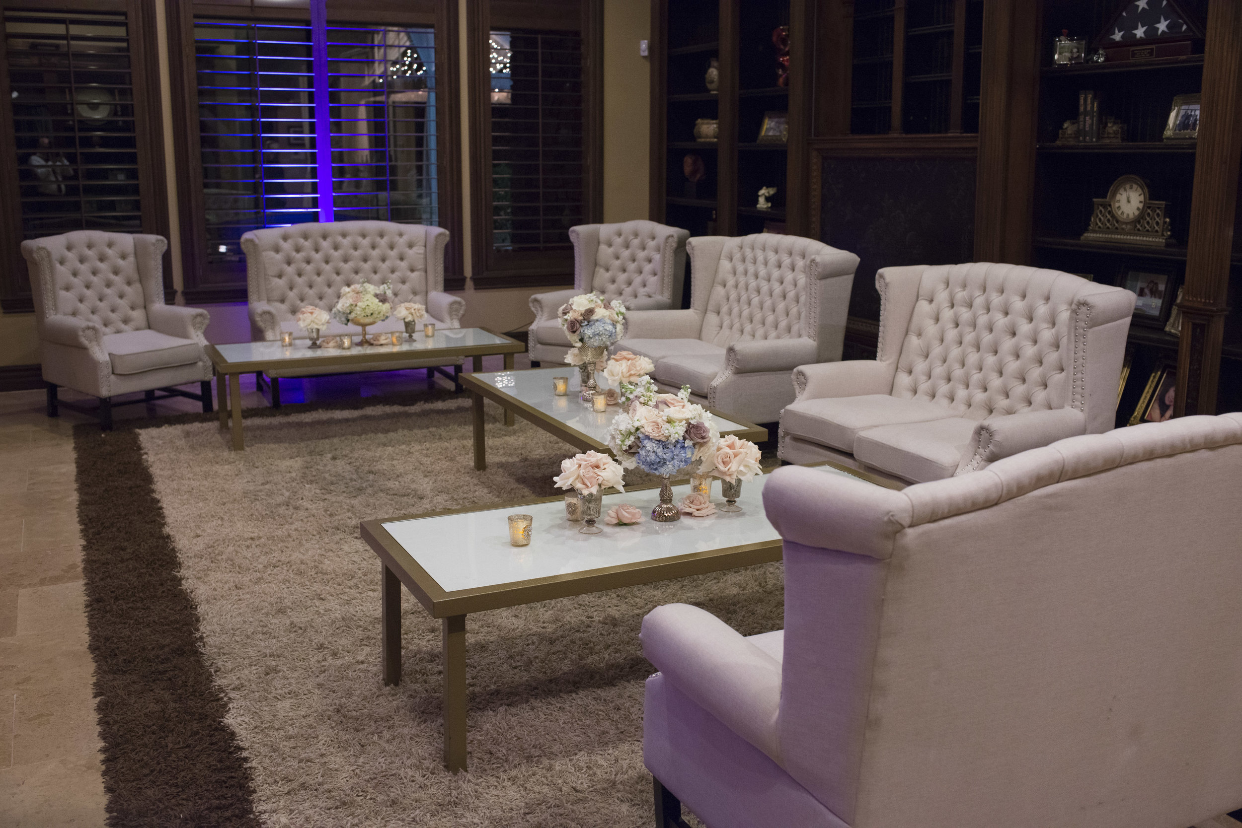 Luxe lounge seating for the after party in a private estate residence in Las Vegas. Tufted furniture for wedding seating. Luxury Las Vegas Wedding Planner Andrea Eppolito. Image by AltF Photography.