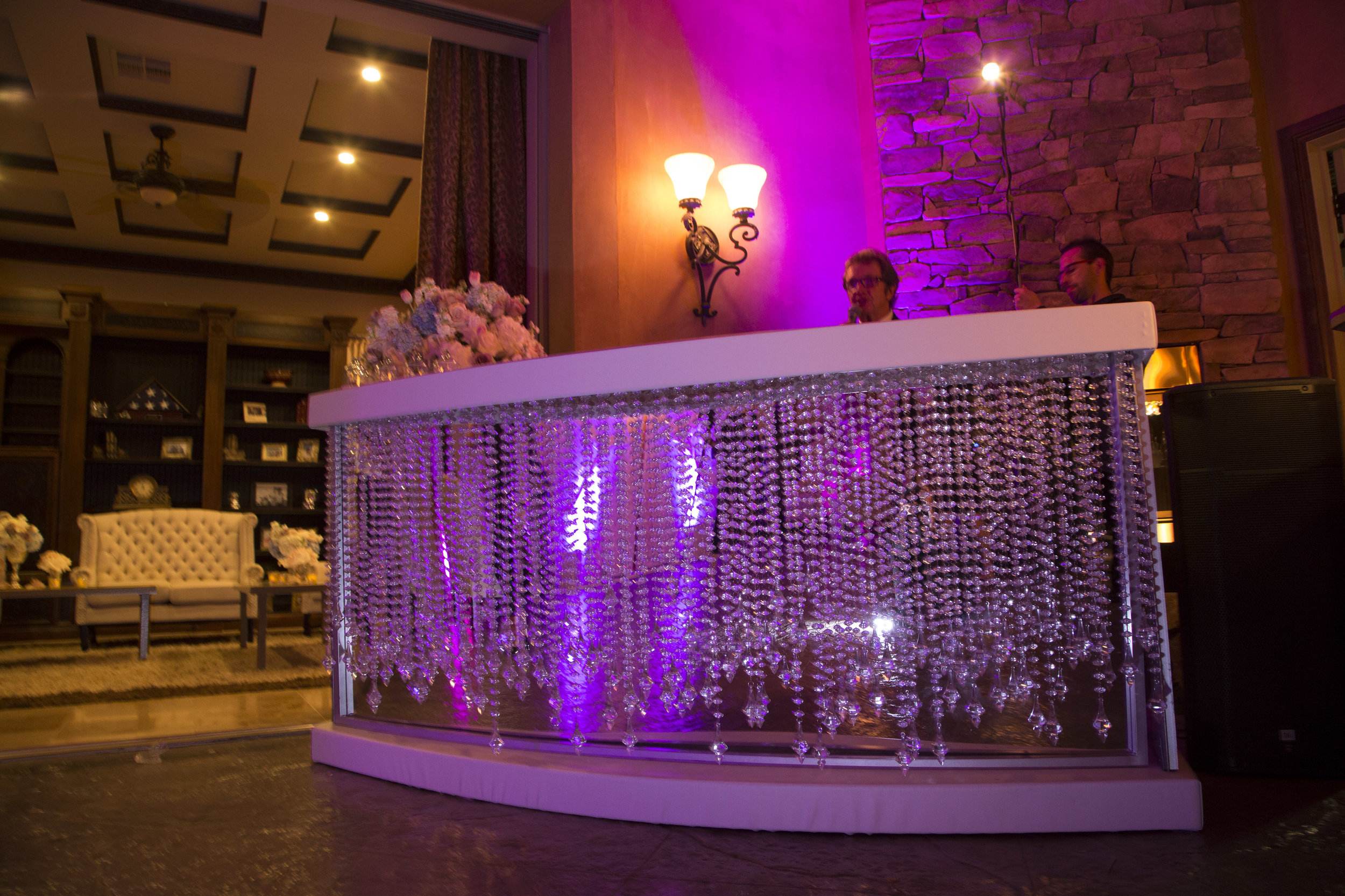 Crystal and white DJ booth for after party. Luxury Las Vegas Wedding Planner Andrea Eppolito. Image by AltF Photography.