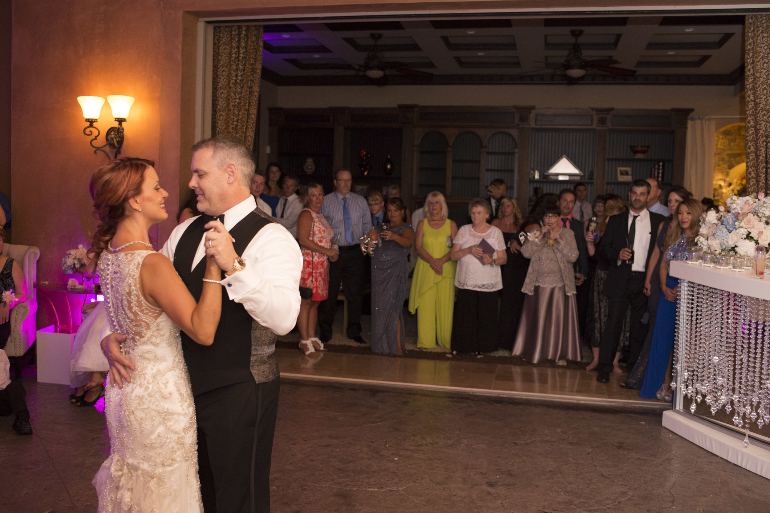 Bride and groom first dance at their after party in their home. Luxury Las Vegas Wedding Planner Andrea Eppolito. Image by AltF Photography.