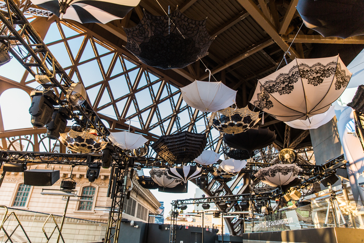 hite and black umbrellas hung upside down from the ceiling truss.  We wanted a dusty feel and a clean color palette of ivory, gold, and black.  Designed by Las Vegas Wedding Planner Andrea Eppolito • Decor by Dzign • Photo by Stephen Salazar