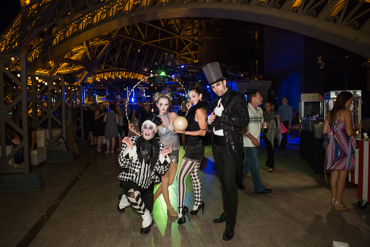 Carnival performers. Designed by Las Vegas Wedding Planner Andrea Eppolito • Decor by Dzign • Photo by Stephen Salazar