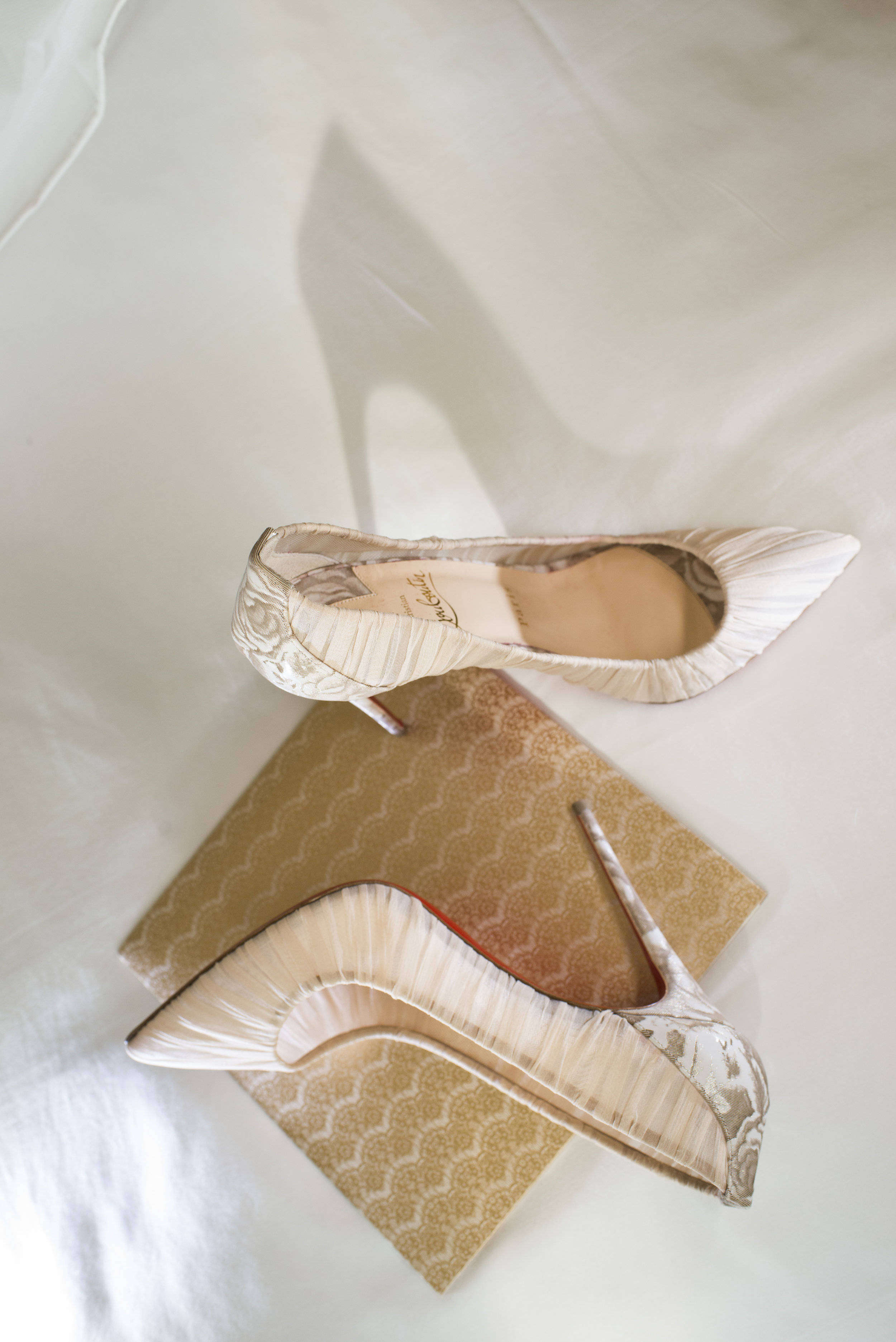 Lovely Loubies. Rose printed Christian Louboutins. http://www.earth13.com/weddings/aaron-and-jennifer/
