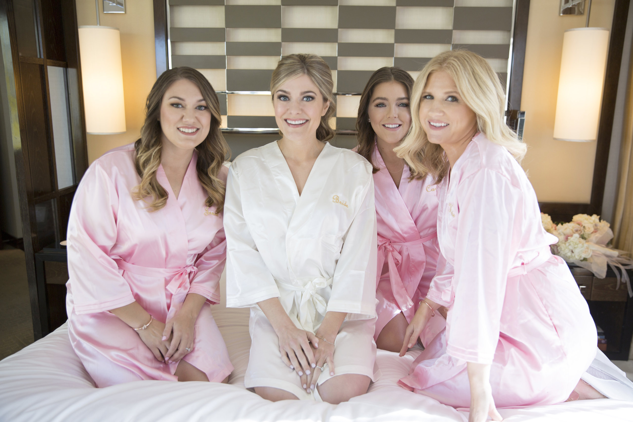 Bridesmaids in matching silk robes. http://www.earth13.com/weddings/aaron-and-jennifer/