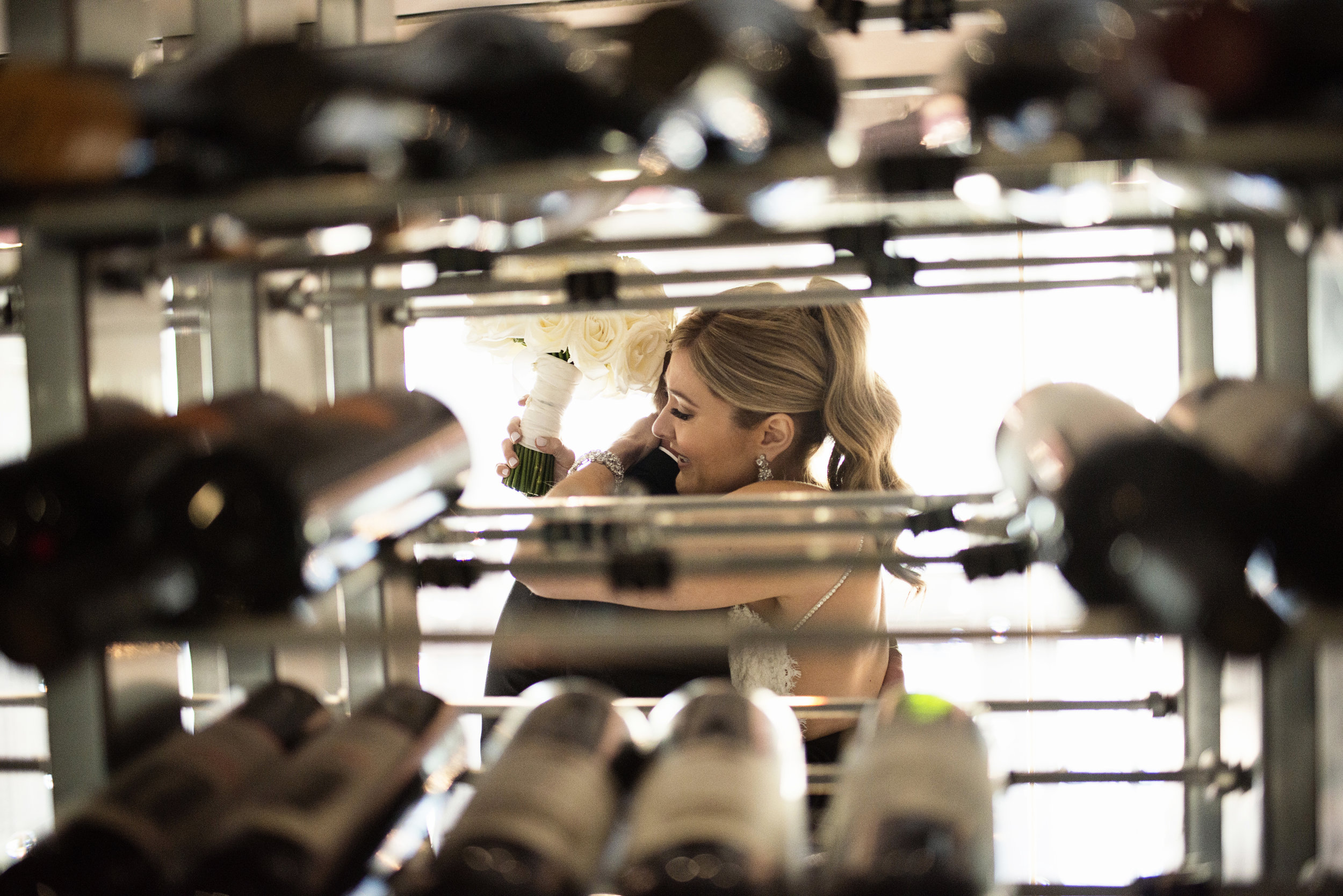 Fist look in a wine tower at TWIST Las Vegas. Wedding Planner Andrea Eppolito.  Image by AltF.