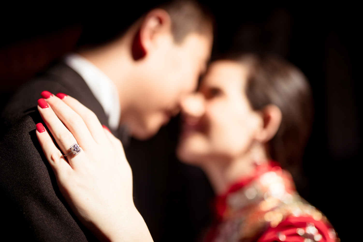Las Vegas Wedding Planner Andrea Eppolito shares these Hong Kong Engagement Photos taken by  Aperture Photo . Goregous red nails and a big emerald cut diamon!