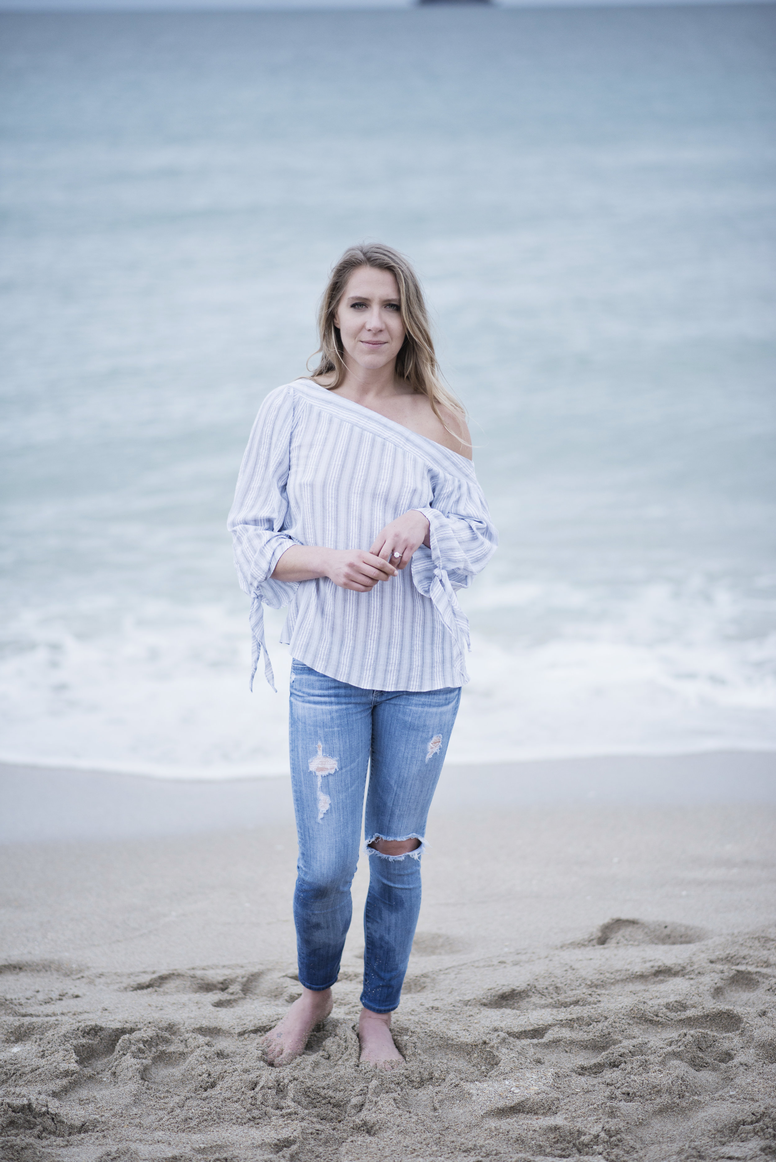 Bride to be Candice by the ocean in Florida. Engagement photos in Florida. Las Vegas Wedding Planner Andrea Eppolito. Image by AltF Photography.
