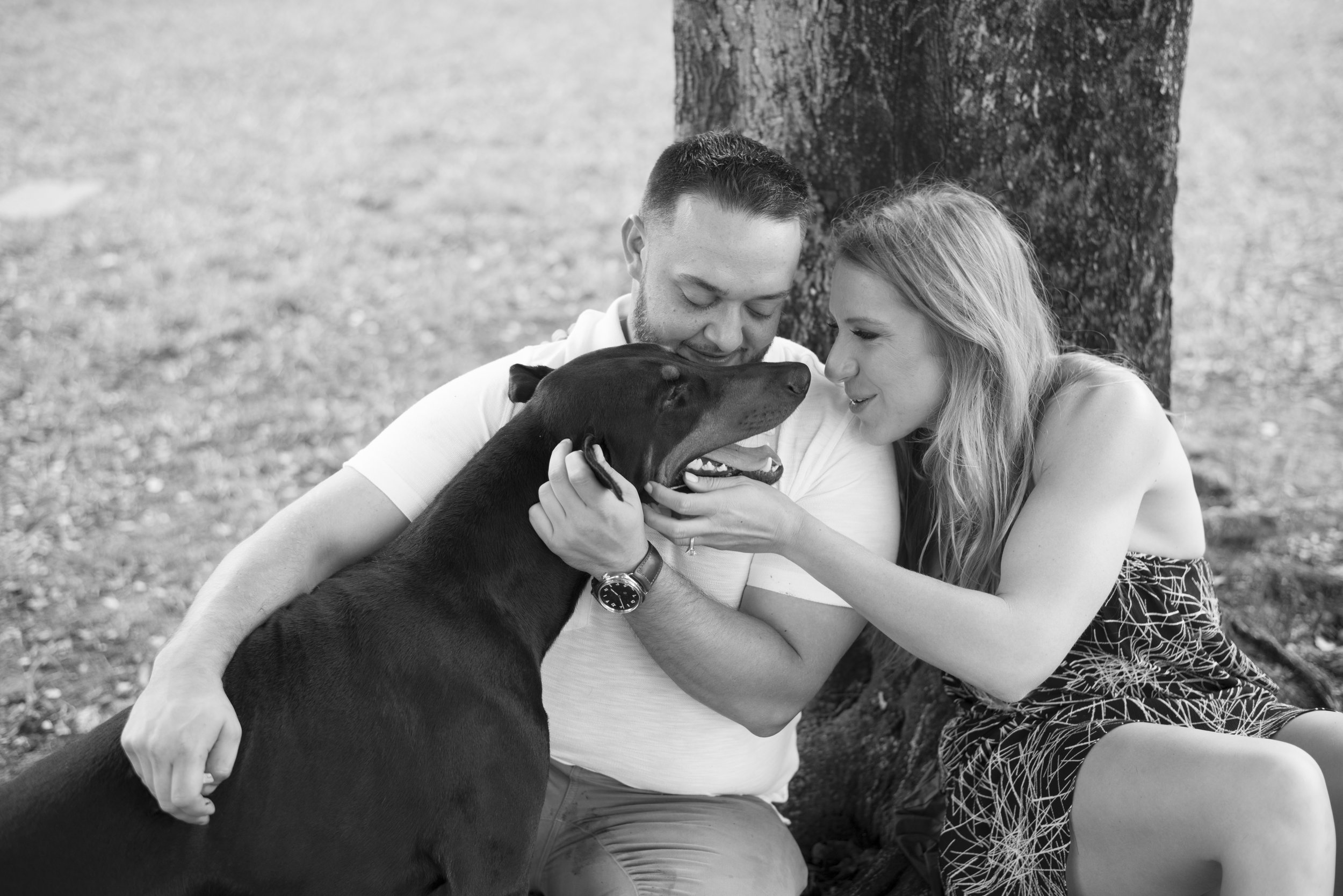 Couple with their dog in engagement photos.Engagement photos in Florida. Las Vegas Wedding Planner Andrea Eppolito. Image by AltF Photography.