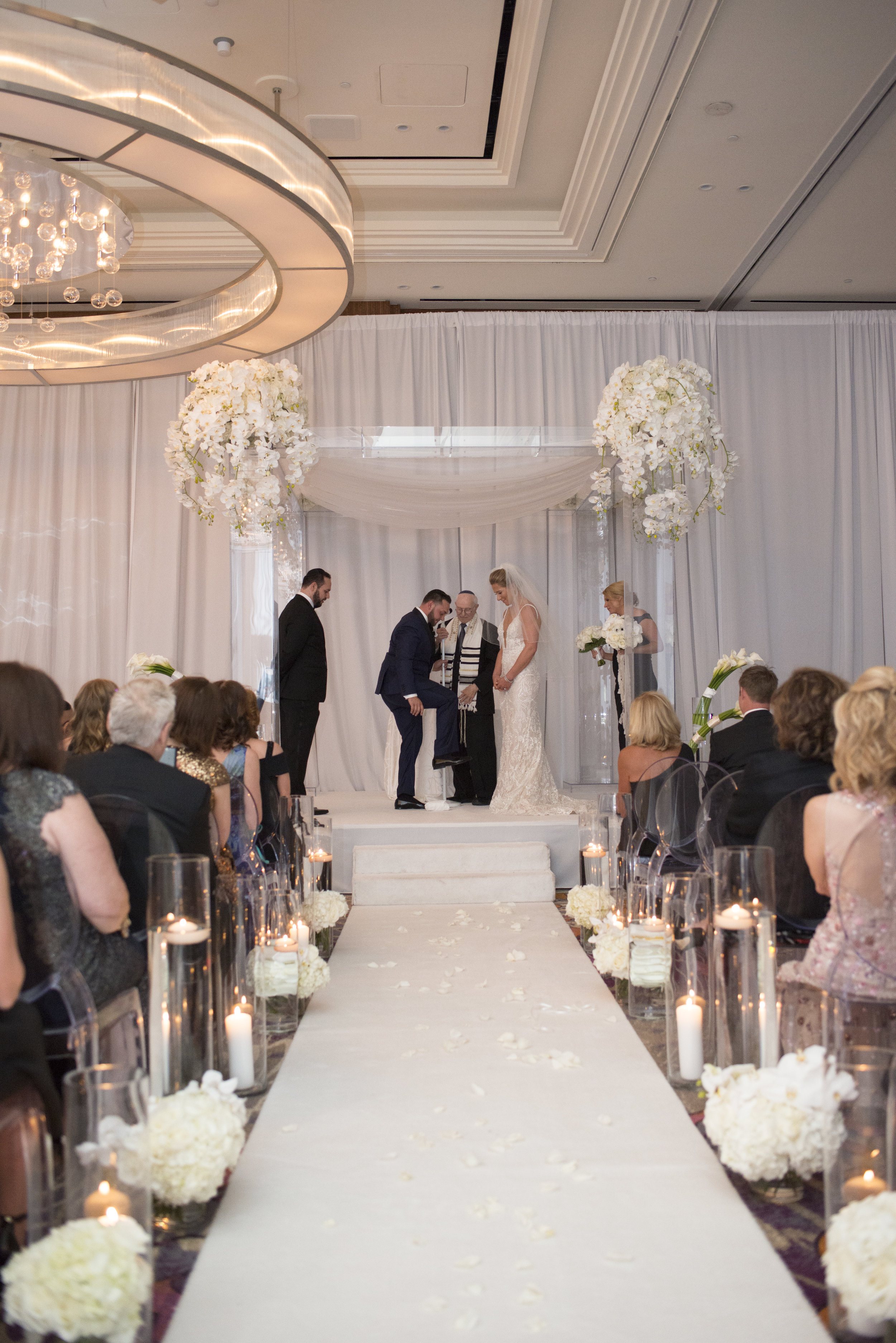 Luxury jewish wedding ceremony at the Mandarin Oriental by Destination Wedding Planner and Event Designer Andrea Eppolito.WEDDING PLANNING & EVENT DESIGN • Andrea Eppolito Events ,PHOTOGRAPHY • AltF Photography ,FLORAL AND DECOR DESIGN & PRODUCTION • Destinations by Design , CATERING • Mandarin Oriental Las Vegas , COCKTAILS •  The Grand Bevy , WEDDING GOWN •  Galia Lahav ,SHOES •  Jimmy Choo