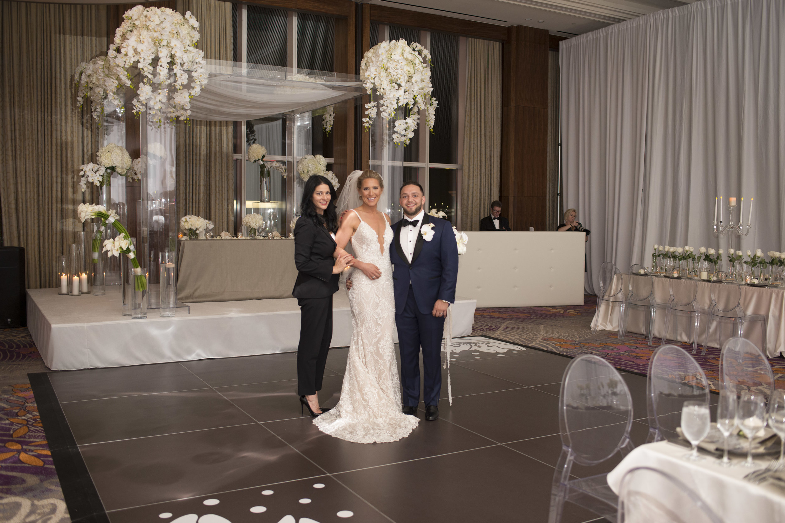 Destination Wedding Planner Andrea Eppolito with bride Candice and groom Ben at their luxury jewish wedding.WEDDING PLANNING & EVENT DESIGN • Andrea Eppolito Events ,PHOTOGRAPHY • AltF Photography ,FLORAL AND DECOR DESIGN & PRODUCTION • Destinations by Design , CATERING • Mandarin Oriental Las Vegas , COCKTAILS •  The Grand Bevy , WEDDING GOWN •  Galia Lahav ,SHOES •  Jimmy Choo , ACRYLIC MENUS & SEATING CHART•  She Paperie