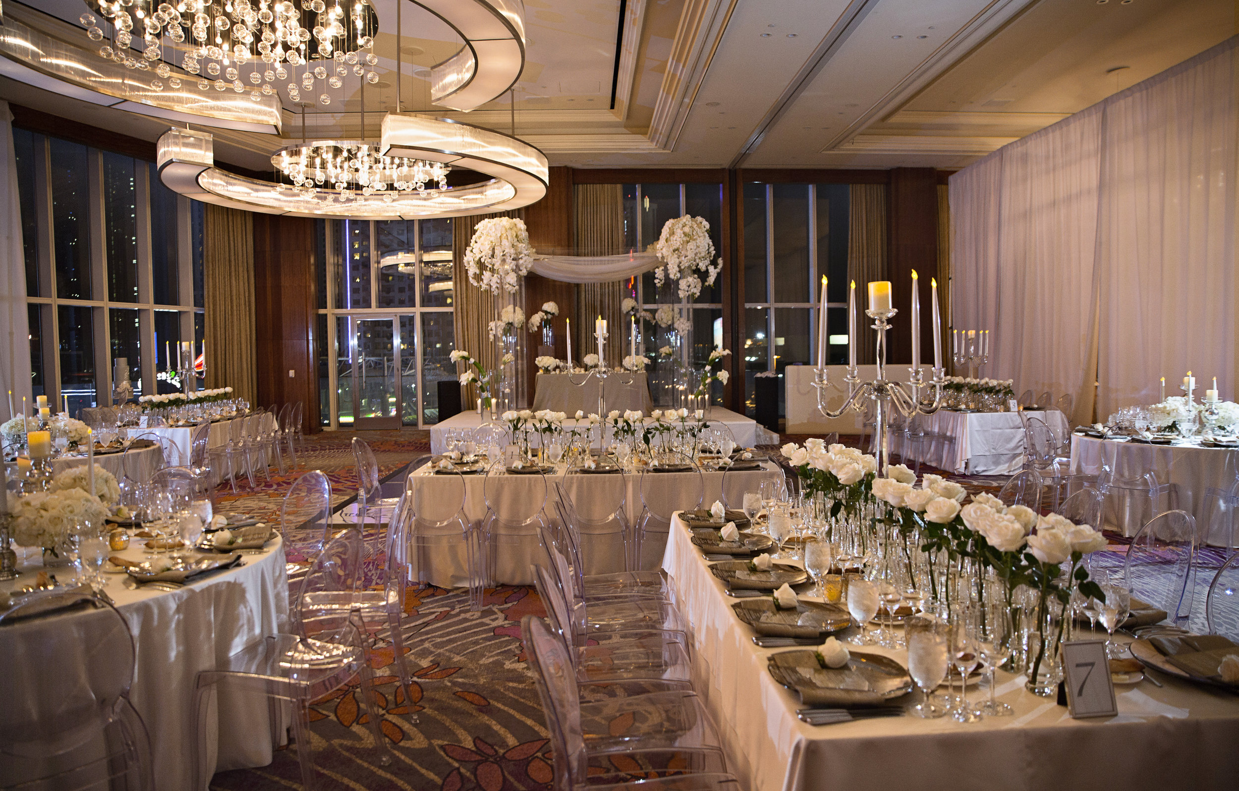 White on white jewish luxury wedding.WEDDING PLANNING & EVENT DESIGN • Andrea Eppolito Events ,PHOTOGRAPHY • AltF Photography ,FLORAL AND DECOR DESIGN & PRODUCTION • Destinations by Design , CATERING • Mandarin Oriental Las Vegas , COCKTAILS •  The Grand Bevy , WEDDING GOWN •  Galia Lahav ,SHOES •  Jimmy Choo , ACRYLIC MENUS & SEATING CHART•  She Paperie