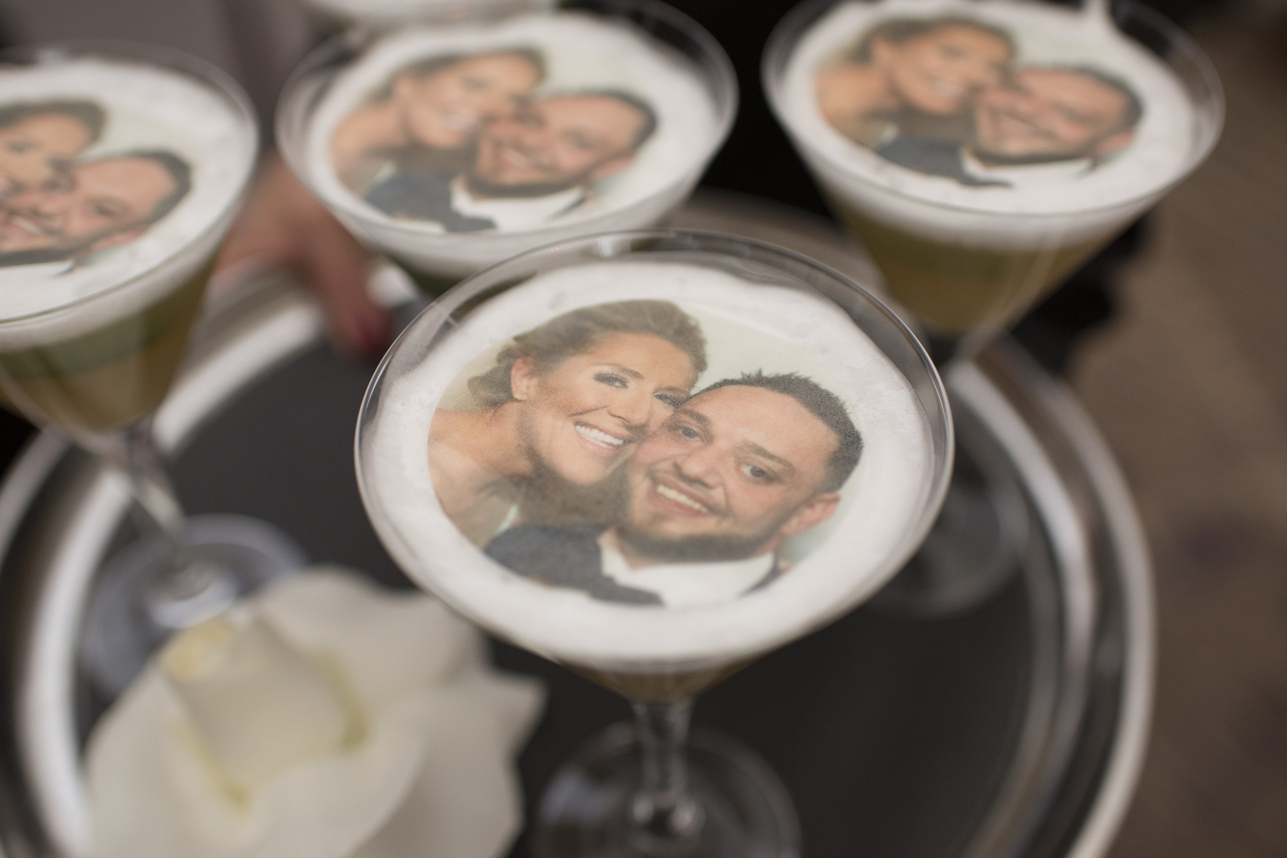 Drink Your Face Off. The SipMi Cocktail from The Grand Bevy. Drinks with the bride and groom's face printed on them. WEDDING PLANNING & EVENT DESIGN • Andrea Eppolito Events ,PHOTOGRAPHY • AltF Photography ,FLORAL AND DECOR DESIGN & PRODUCTION • Destinations by Design , CATERING • Mandarin Oriental Las Vegas , COCKTAILS •  The Grand Bevy , WEDDING GOWN •  Galia Lahav ,SHOES •  Jimmy Choo , ACRYLIC MENUS & SEATING CHART•  She Paperie
