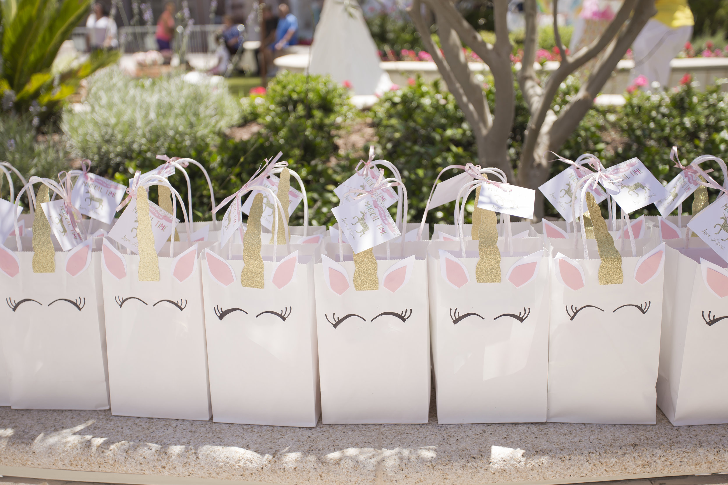 Unicorn gift bags.  Celebrity Event Planner Andrea Eppolito.  Floral and Rentals by Destinations by Design. Photo by Triple Vision Studios.