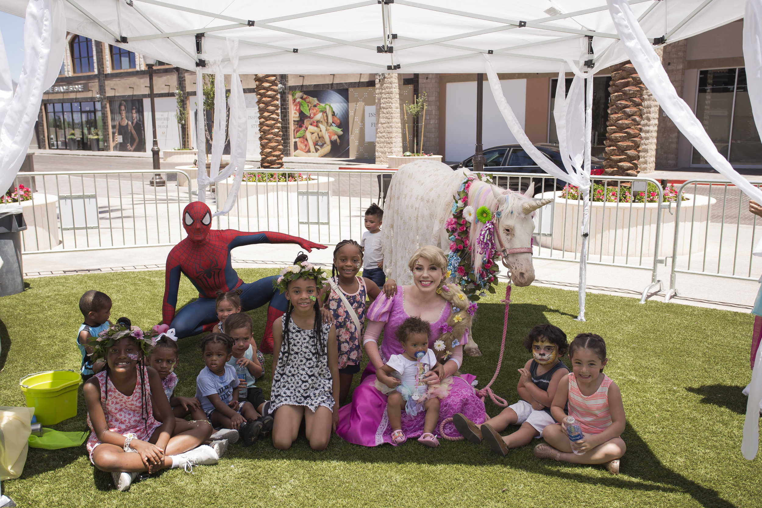 Group photo of kids with unicorn at 1st birthday party.  Celebrity Event Planner Andrea Eppolito.  Floral and Rentals by Destinations by Design. Photo by Triple Vision Studios.