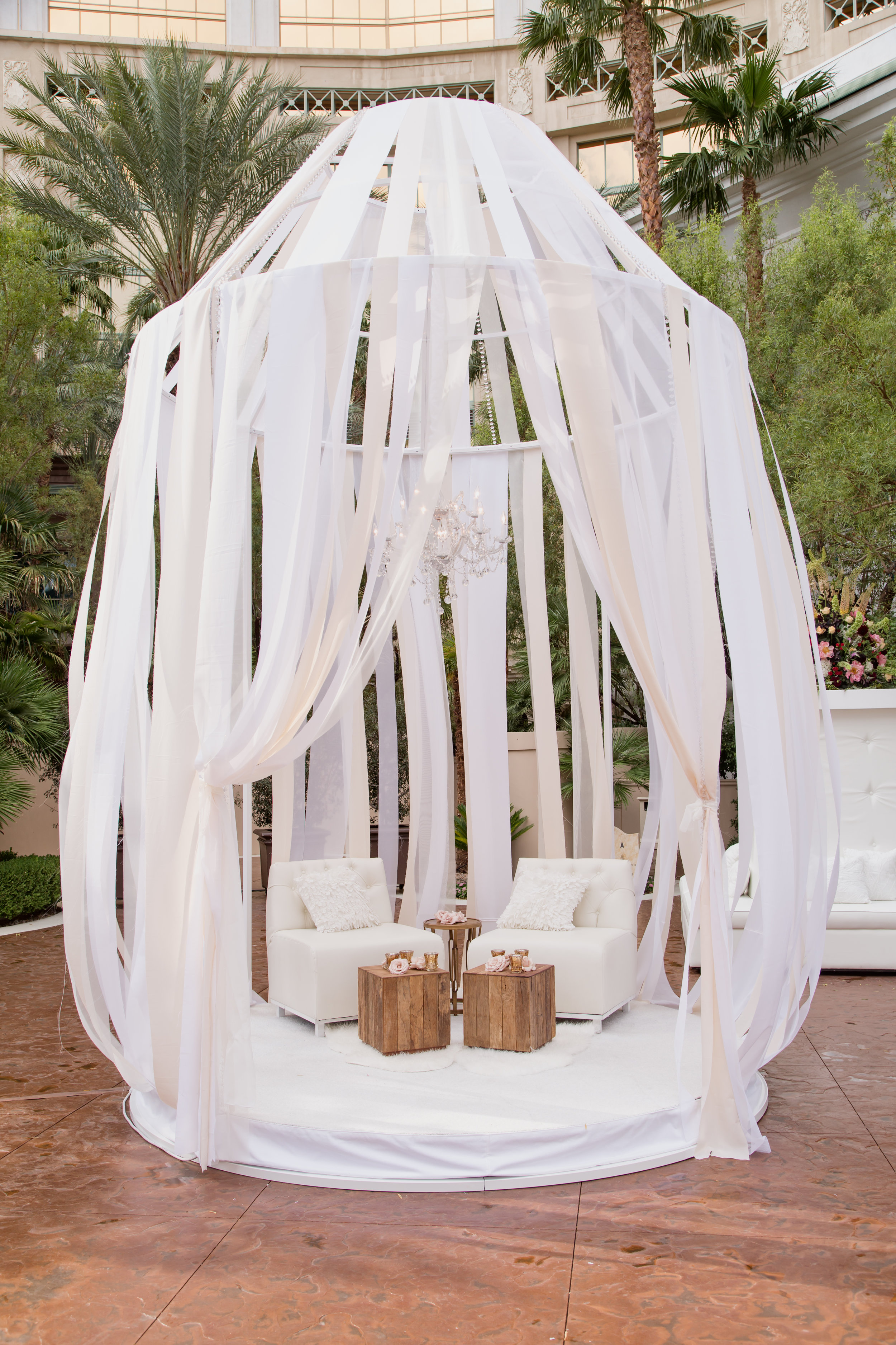Ceremony birdcages with ribbons at luxury, upscale destination wedding.Destination Wedding Planner  Andrea Eppolito ·Photos by  Adam Frazier Photography ·Floral and Decor by  Destinations by Design · Lighting by  LED Unplugged ·Venue · Invitations  Ceci New York  · Menus by  Alligator Soup