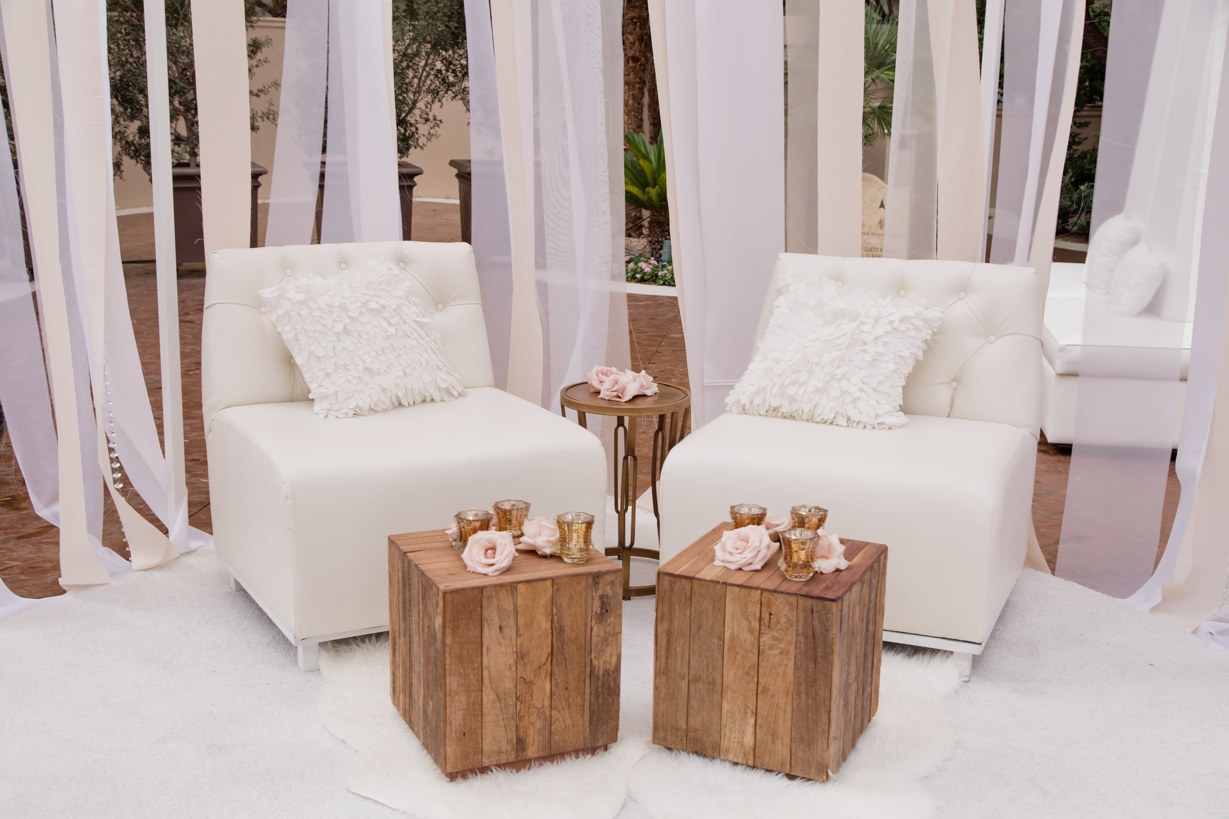 White club chairs and wooden tables at upscale wedding in Las Vegas. Destination Wedding Planner  Andrea Eppolito ·Photos by  Adam Frazier Photography ·Floral and Decor by  Destinations by Design · Lighting by  LED Unplugged ·Venue · Invitations  Ceci New York  · Menus by  Alligator Soup