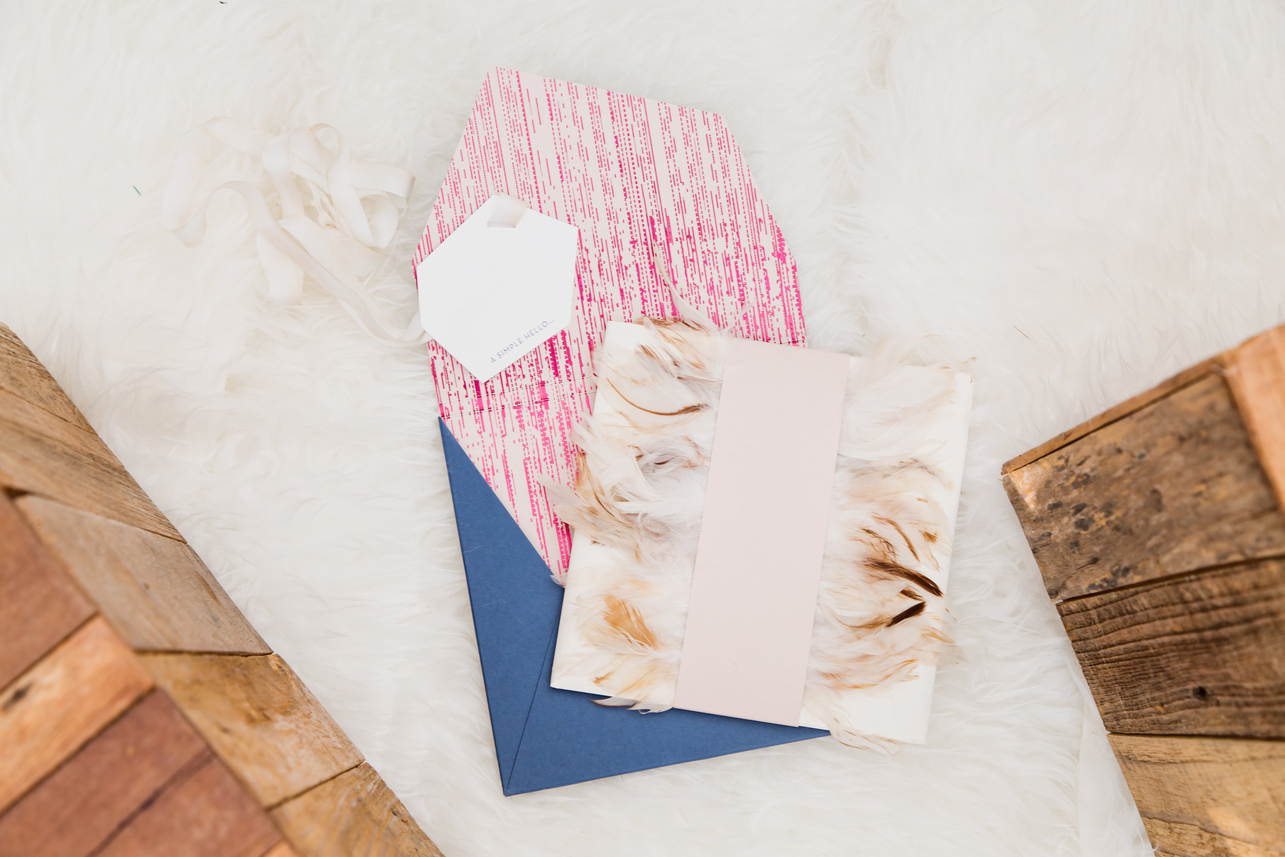 Luxury invitations with feathers.Destination Wedding Planner  Andrea Eppolito ·Photos by  Adam Frazier Photography ·Floral and Decor by  Destinations by Design · Lighting by  LED Unplugged ·Venue · Invitations  Ceci New York  · Menus by  Alligator Soup